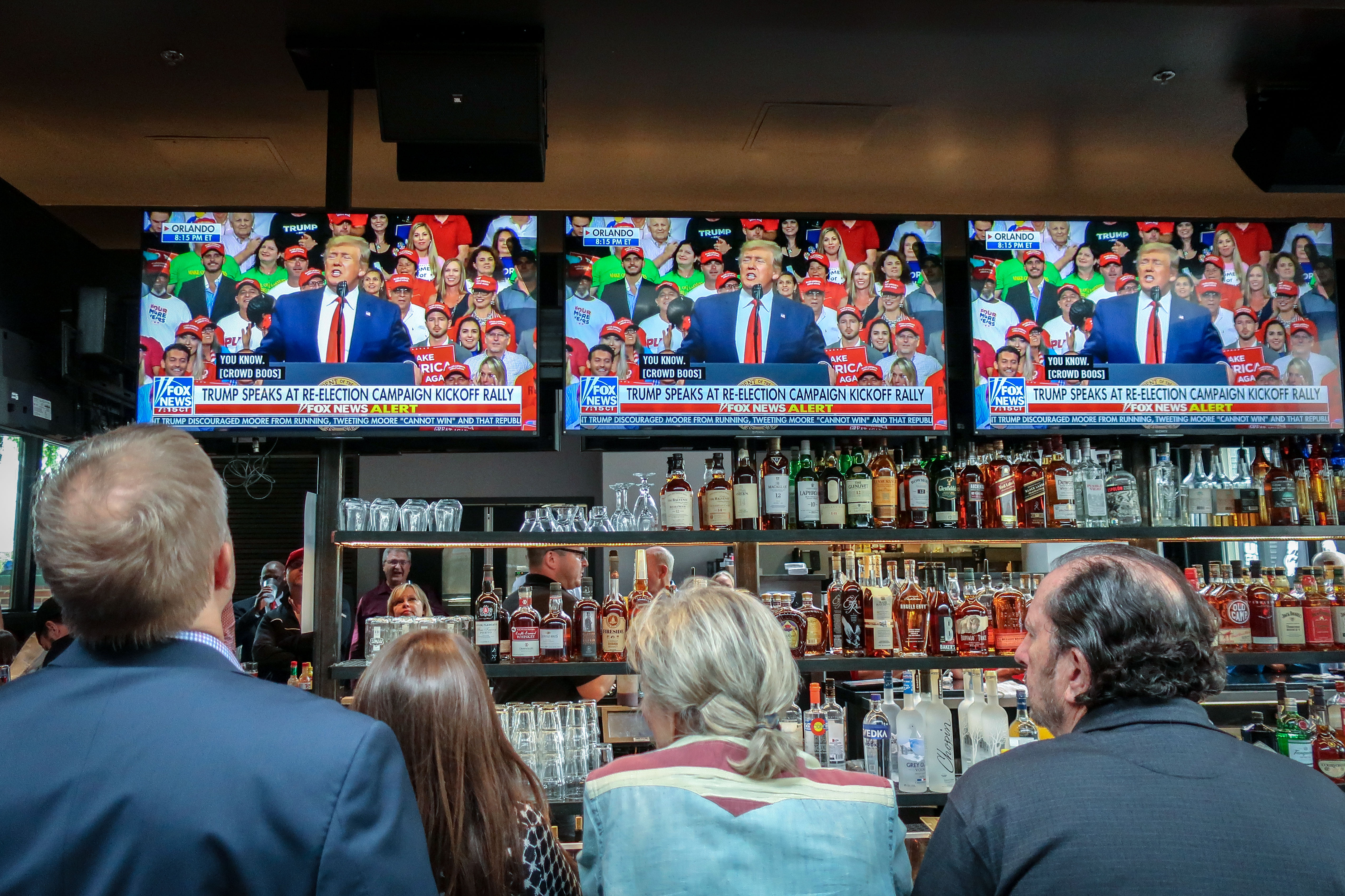 Denver Republicans watch President Donald Trump launch his 2020 campaign with a speech from Orlando, Fla., June 18, 2019.