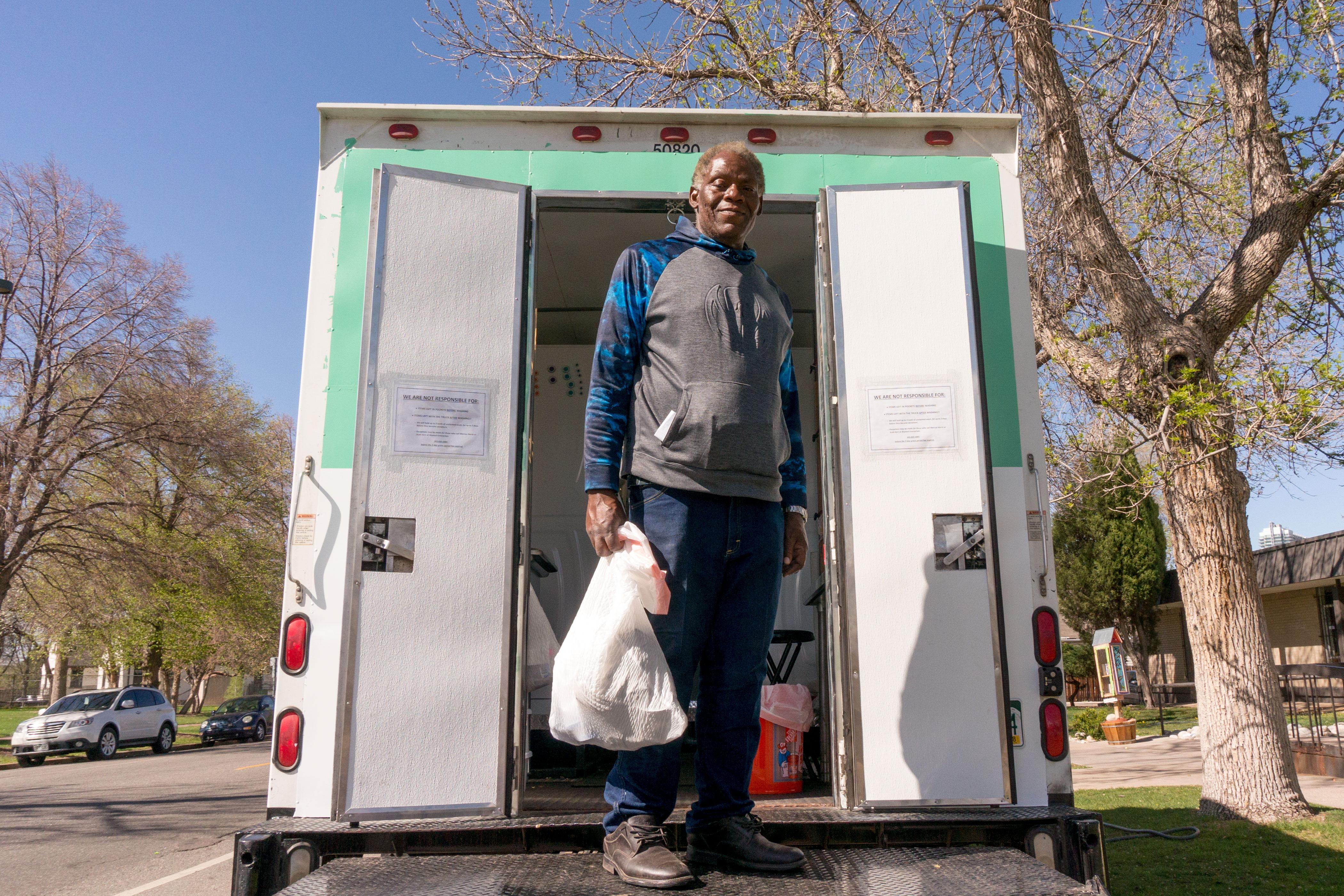 Photo: Bayaud Enterprises' The Laundry Truck_Glen Watkins on the truck