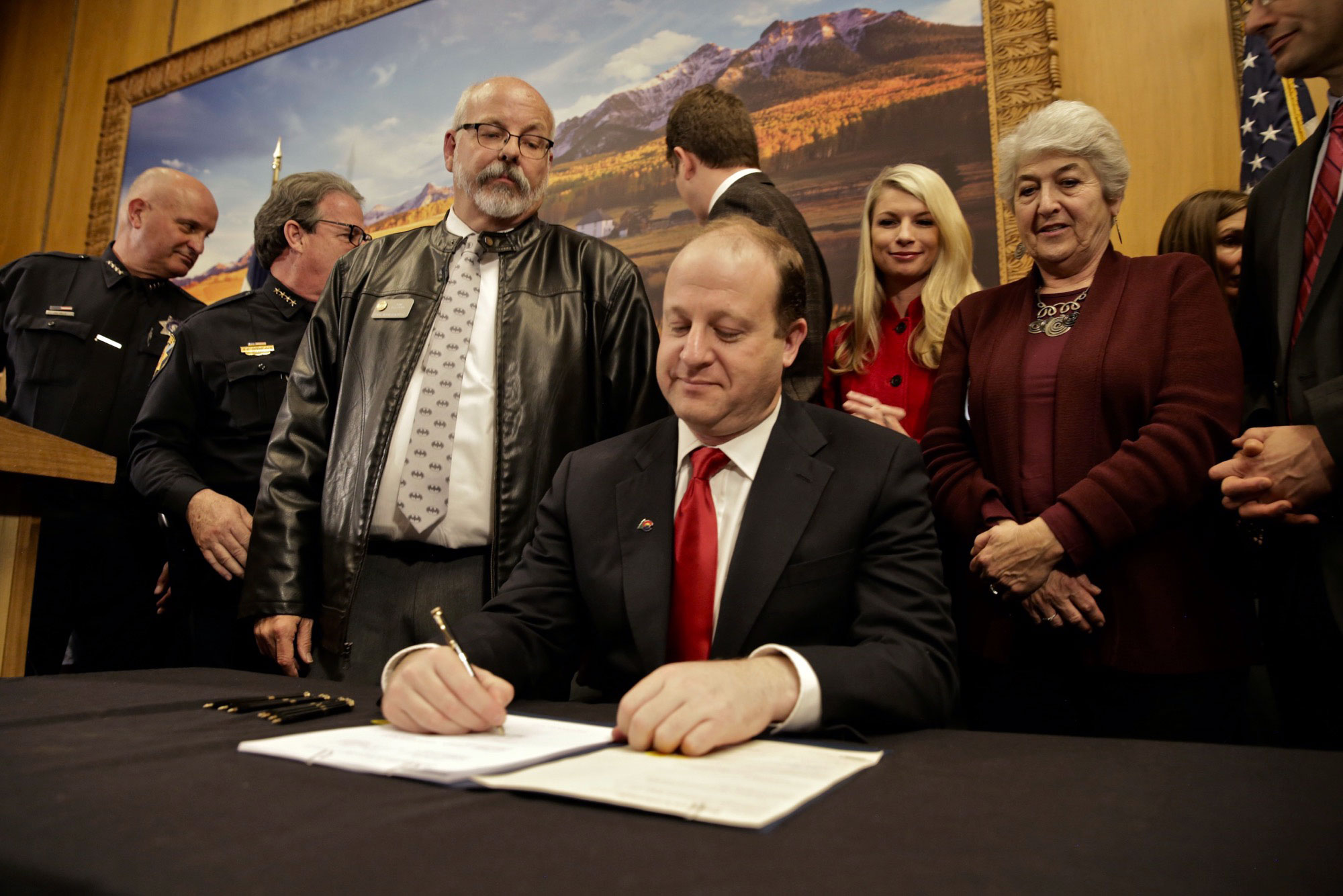 Photo: Gov. Jared Polis Rep. Tom Sullivan Red Flag Gun Law Signing