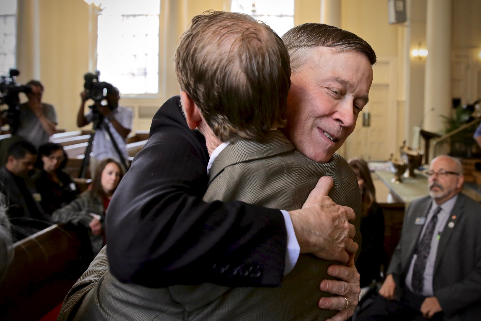 """<p> <style type=""""text/css"""">p.p1 {margin: 0.0px 0.0px 0.0px 0.0px; font: 12.0px 'Helvetica Neue'} </style> Presidential candidate and former Colorado Gov. John Hickenlooperembraces Michael Davis as he meets with the families of victims of mass shootings on Tuesday at First Baptist Church in downtown Denver. Michael Davis and his wife Desiree, who was also at the gathering, are the parents of Claire Davis, who was killed in a shooting at Arapahoe High School.</p>"""