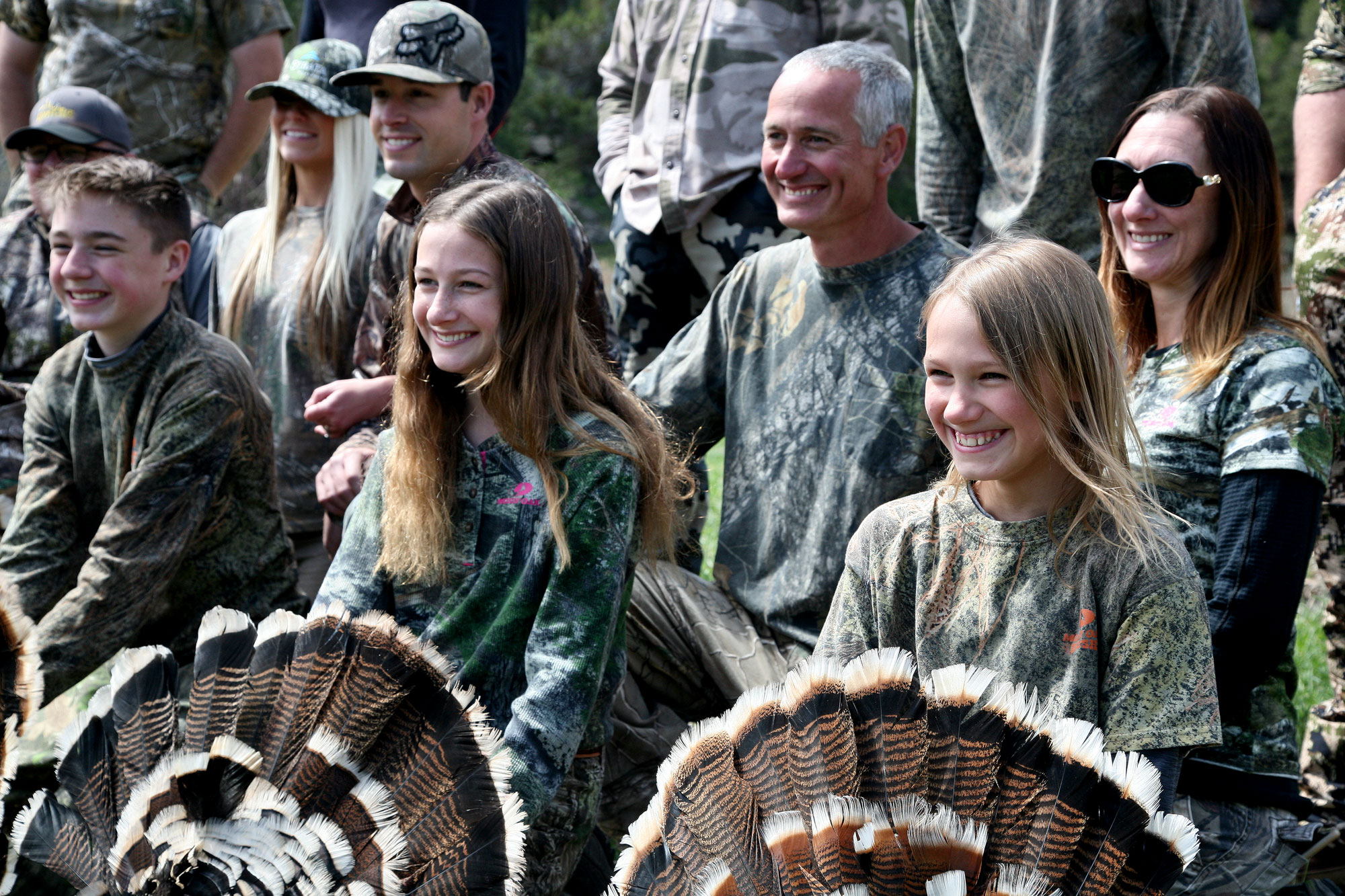 This year was a bountiful one for the annual Colorado Parks and Wildlife Youth Hunter Outreach Program turkey hunt, with six out of seven youngsters taking a turkey. From left, Hunter Snow, 14, and sisters Savannah and Hailey Jones, ages 13 and 11. Behind, from left, are parents Amber and Andy Snow, and John and Jenny Jones.