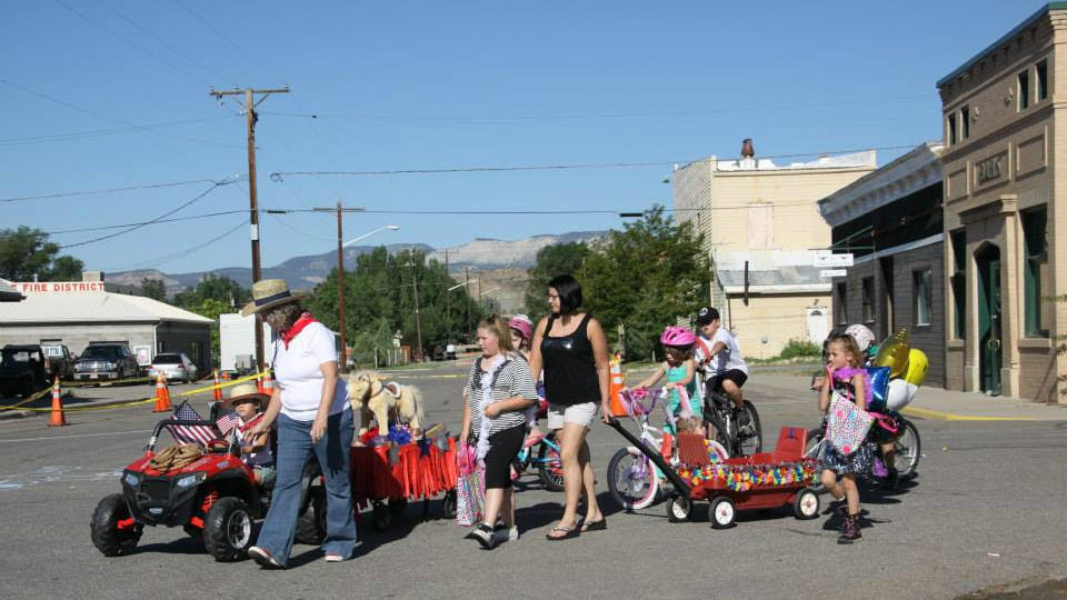 Photo: Families attend the Wild Horse Days festivities in downtown DeBeque