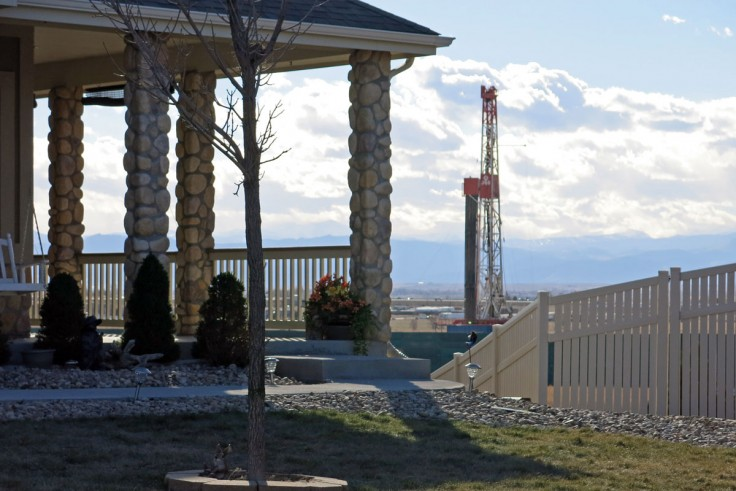 Photo: An oil and gas rig near a home in Weld County