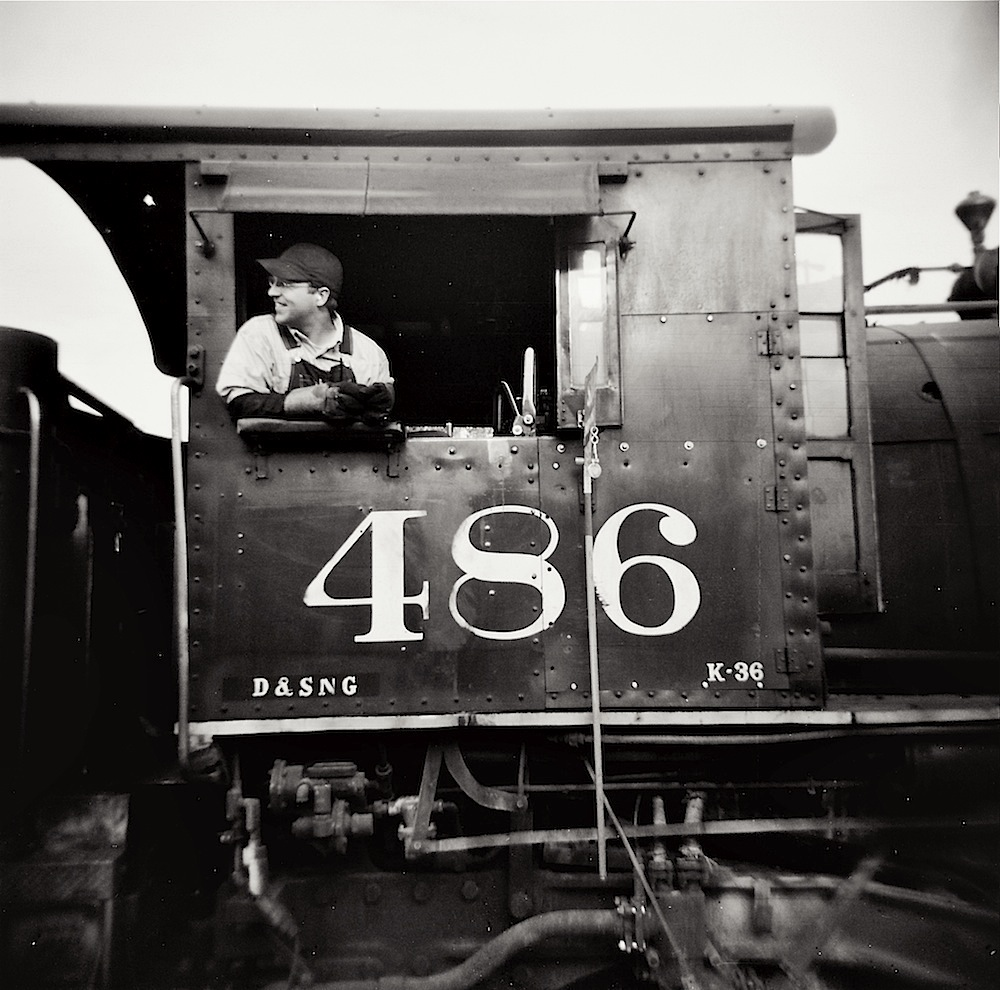 A Durango & Silverton Narrow Gauge Railroad engineer, black and white (HV)