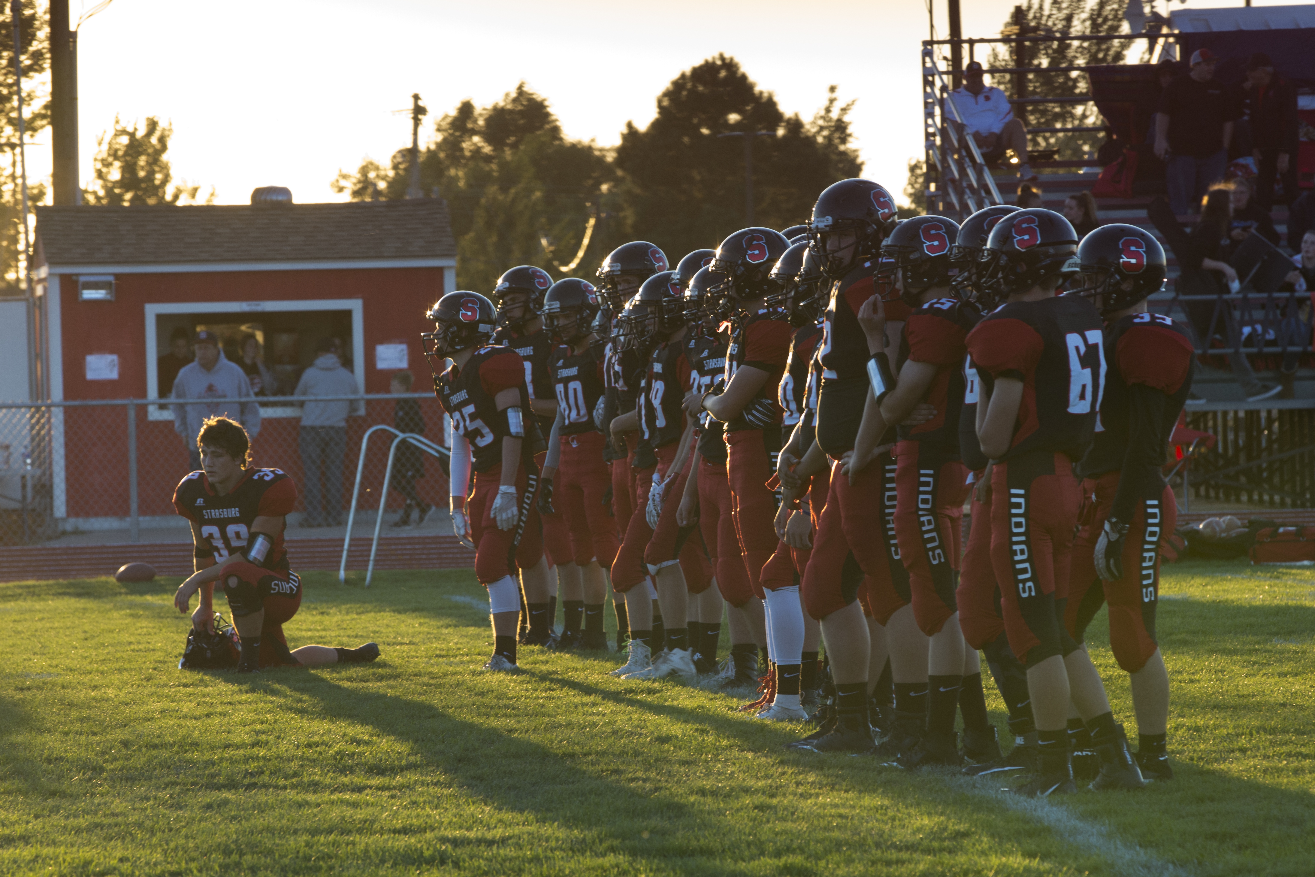 """Members of the Strasburg High School Indians football team line up for warmups Friday Sept. 21 2018 ahead of their home game against Limon. Work began on the first schoolhouse in the area in 1886. <a href=""""http://www.ssd31j.org/Content/SSD-History"""">The modern high school</a> on the northern side of downtown, built in 1976, serves <a href=""""https://www.publicschoolreview.com/strasburg-high-school-profile"""">315 students</a>."""