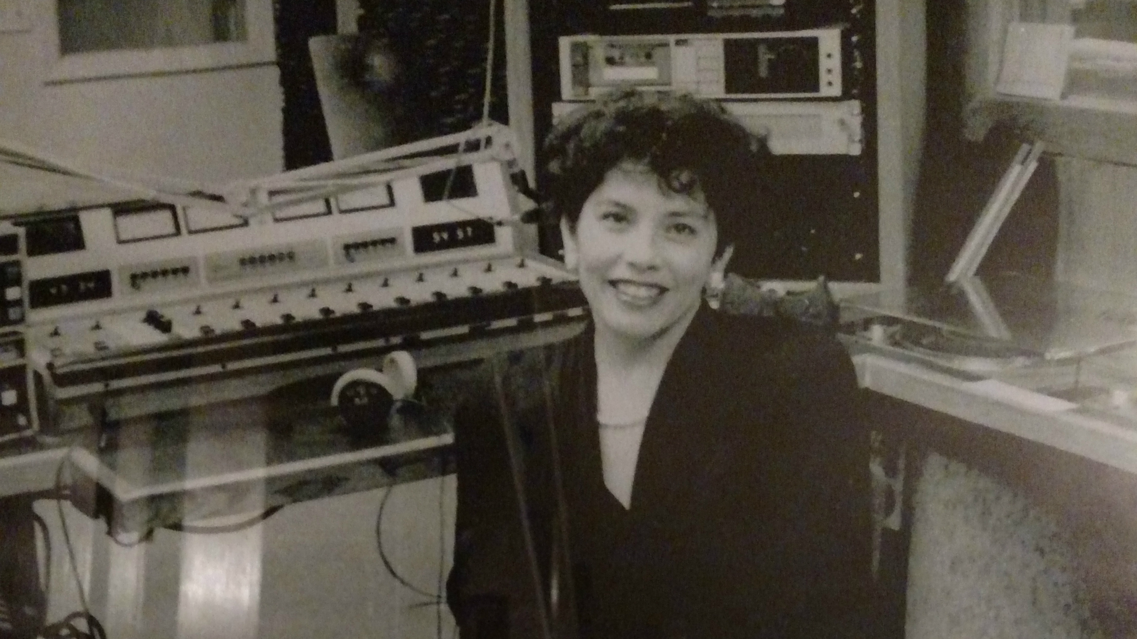 Photo: KUVO founder Florence Hernandez Ramos in a 1980s radio studio CROPPED
