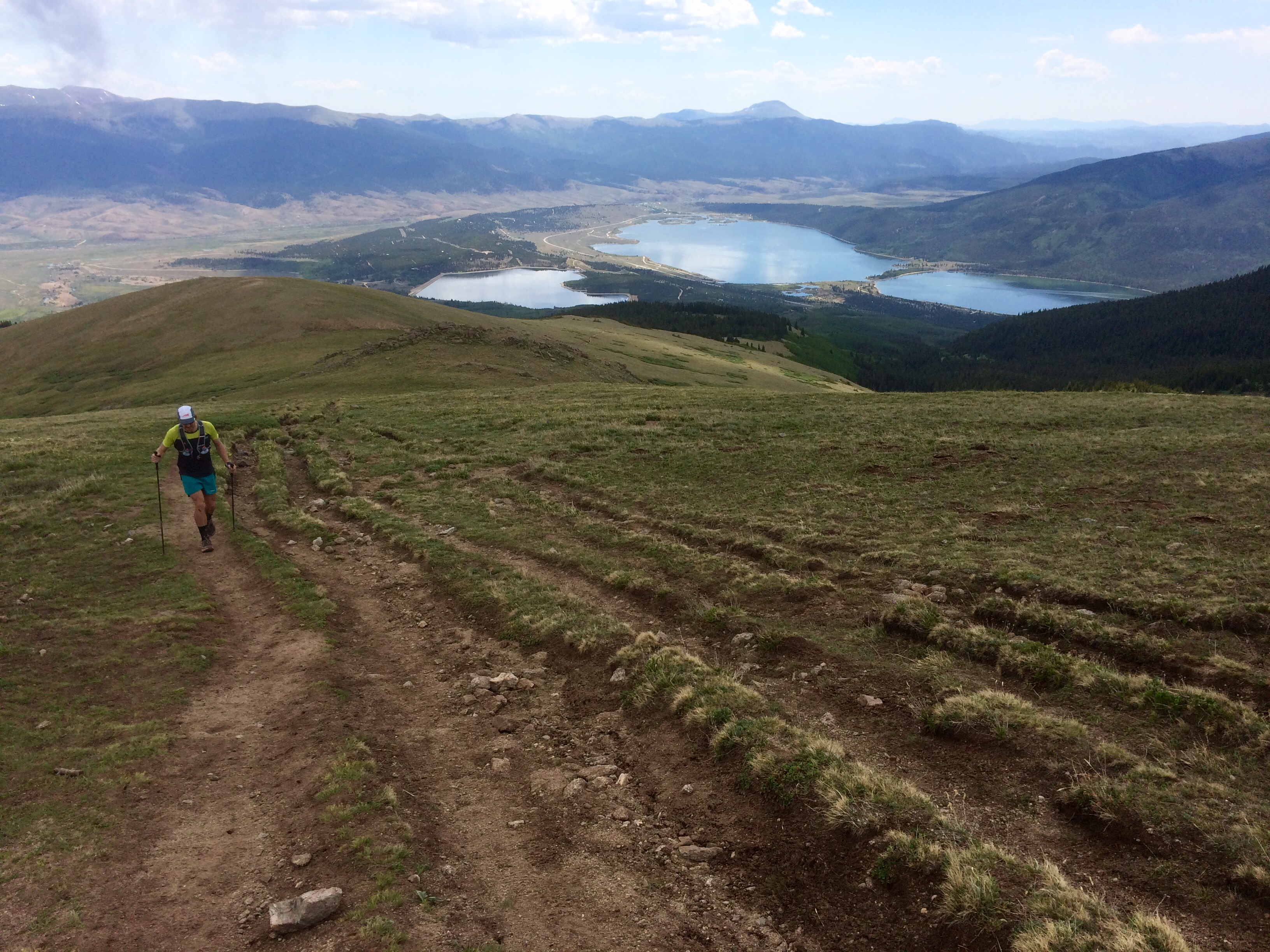 A hiker above treeline on Mt. Elbert, Colorado'shighest mountain, walks to the side of the heavily damaged trail up the East Ridge in July 2017.