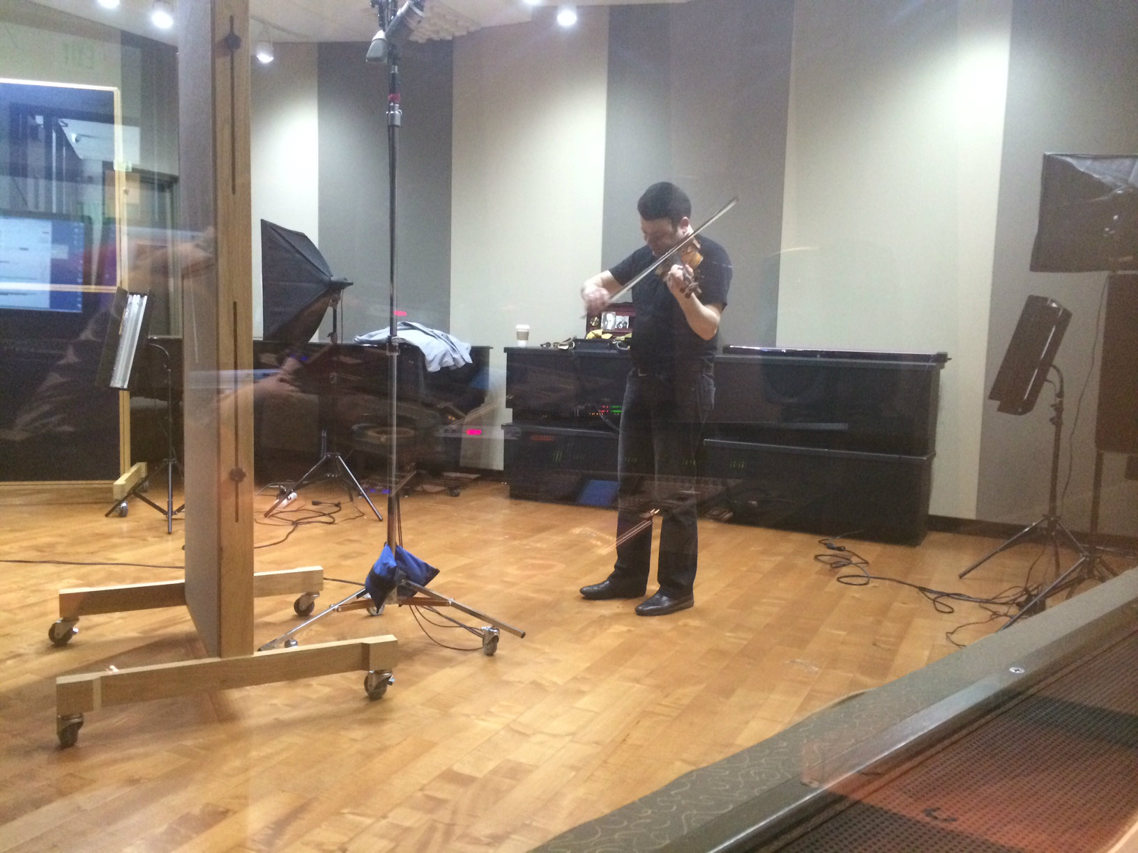 Photo: Violinist Vadim Gluzman behind the glass in the CPR Performance Studio