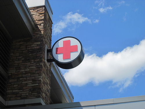 Photo: Hospital sign and wellness symbol (stock)