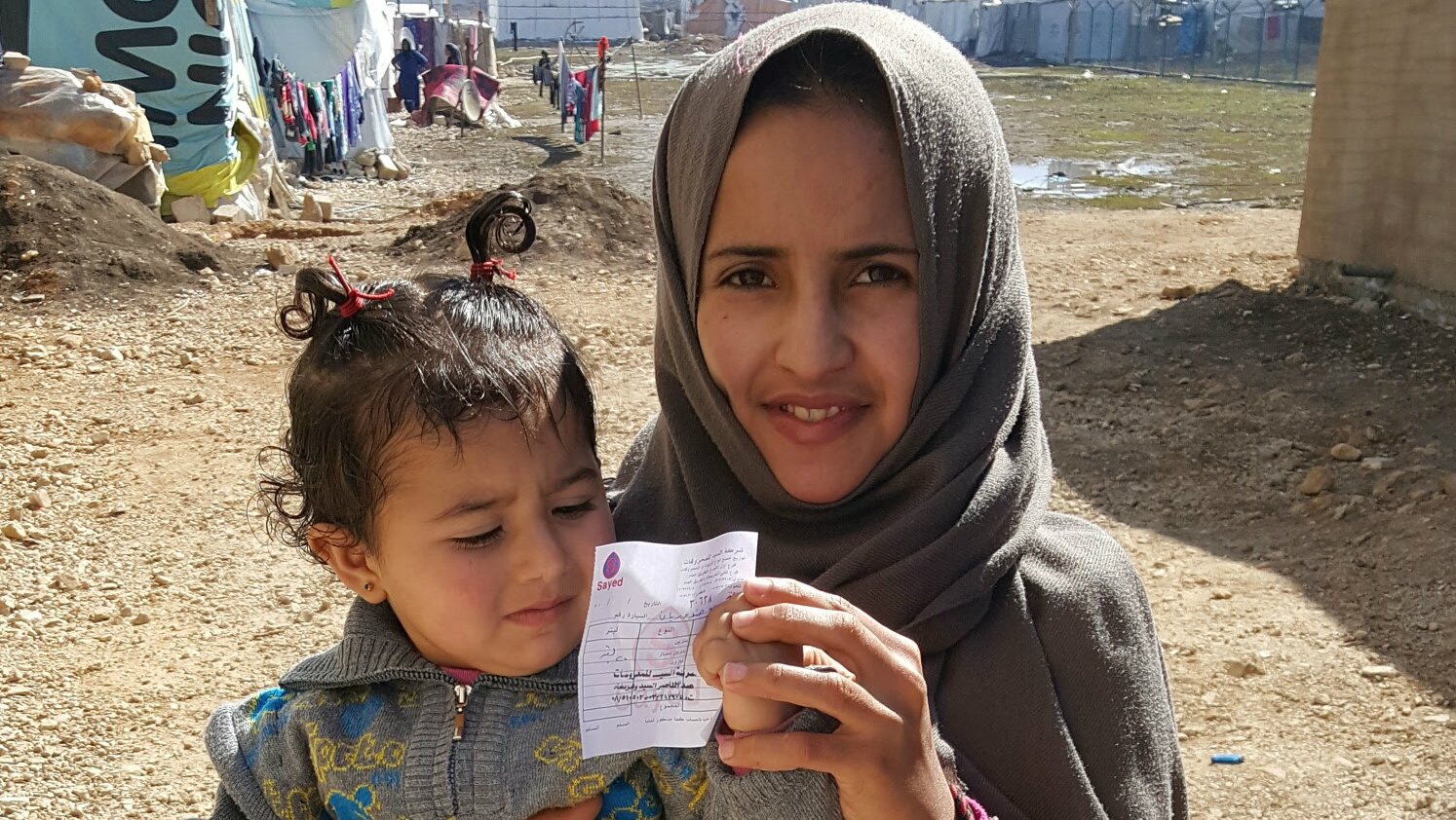 Photo: Humanwire Syria aid family with receipt