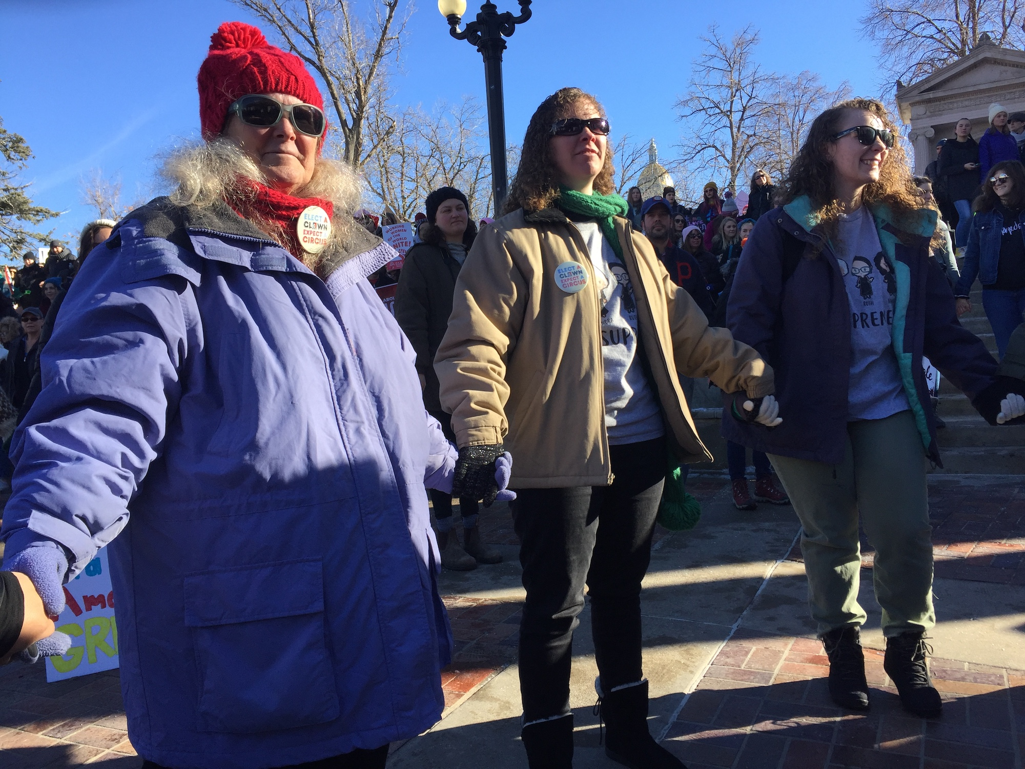 Photo: women's marc 2019   women hold hands at the Womxn's March Denver 2019 to demonstrate the march's theme of unity-- Natalia V. Navarro