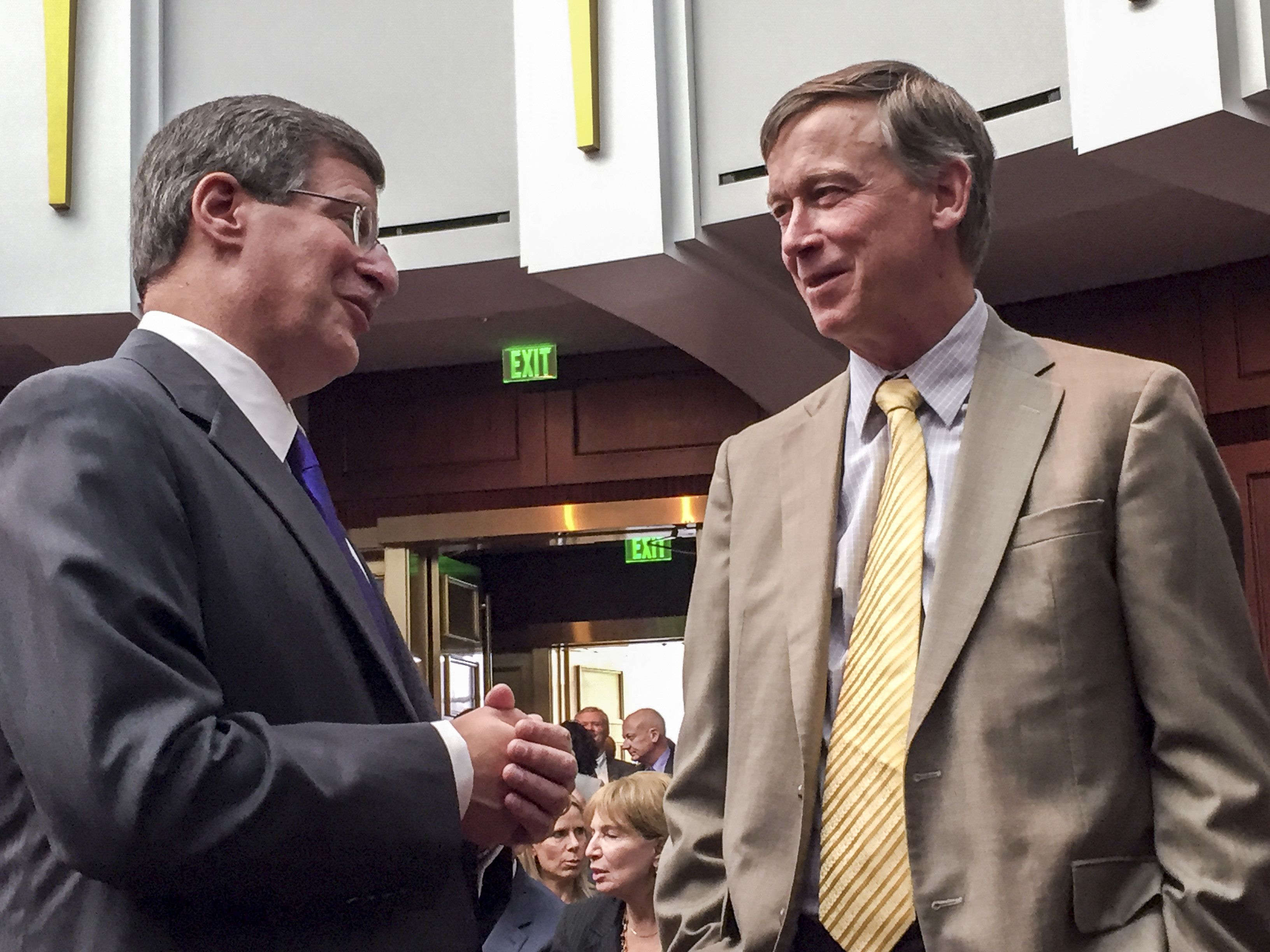 Photo: Supreme Court Justice Richard Gabriel, Gov. Hickenlooper (Staff)
