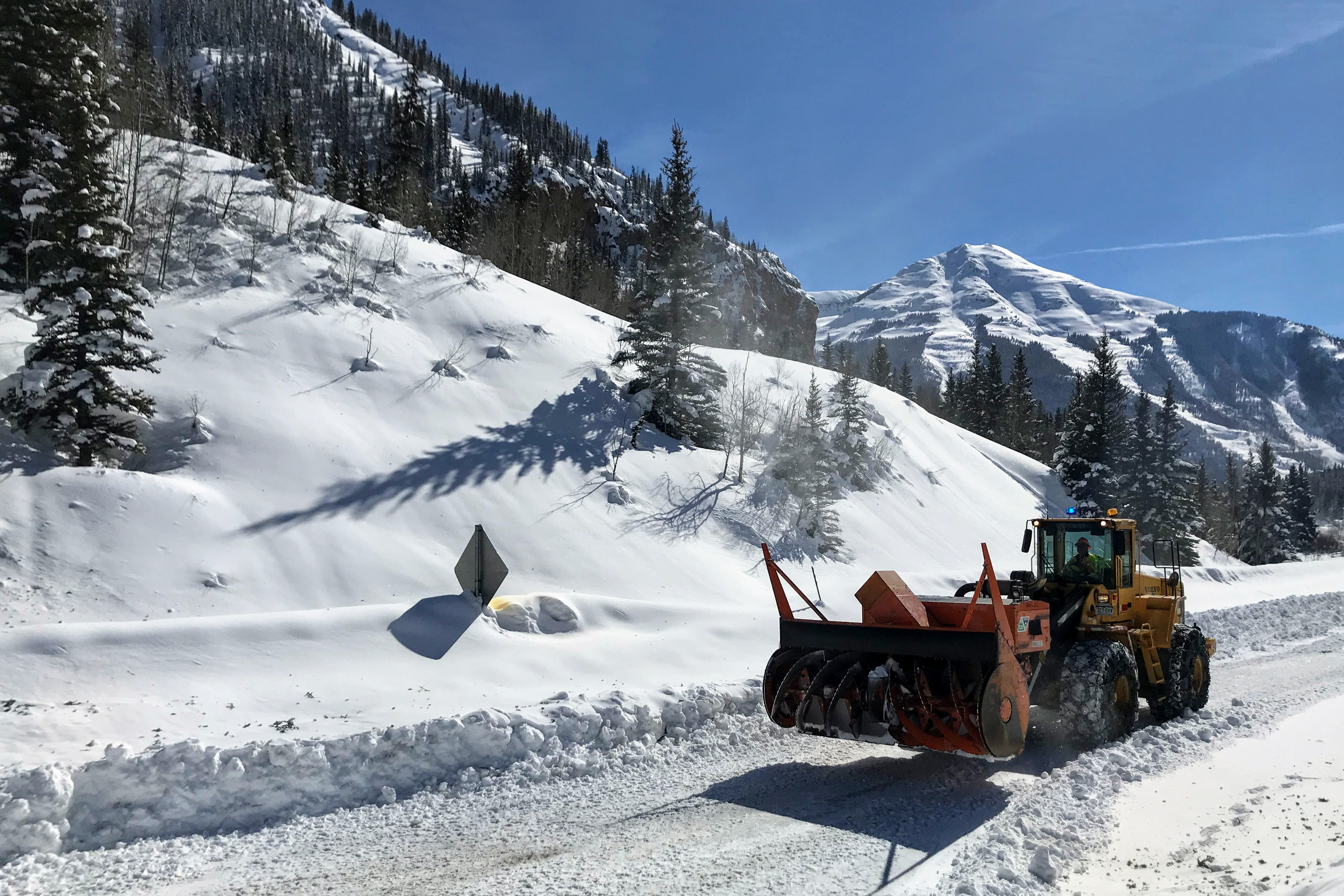<p>CDOT crews work to clear the Red Mountain Pass after avalanches and snow slides covered the road.</p>