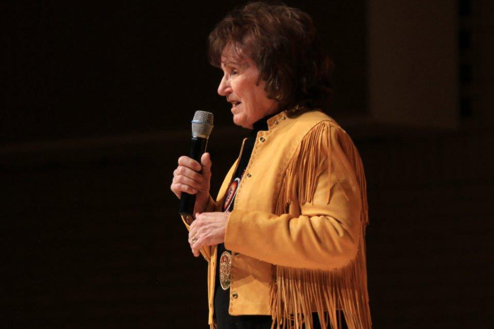 Photo: Yvonne Hollenbeck recites cowboy poetry