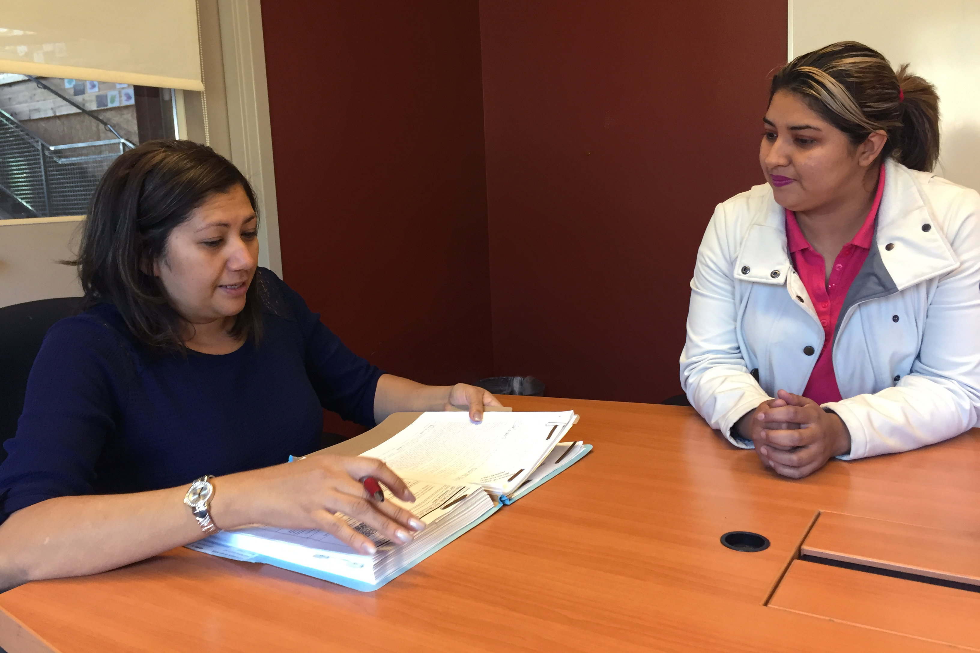 Photo: immigrant legal services 1 | An asylum seeker talks with her lawyer at the Justice and Mercy Legal Aid Center- Natalia V. Navarro