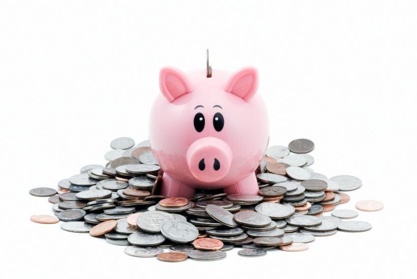 Photo: Piggy bank and coins