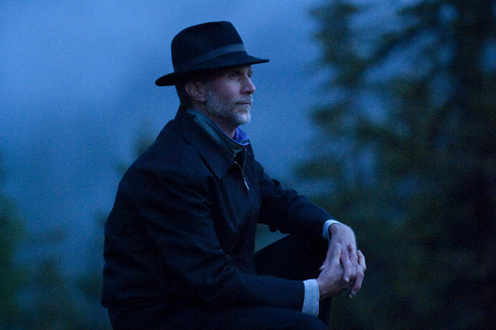 Photo: John Luther Adams crouching