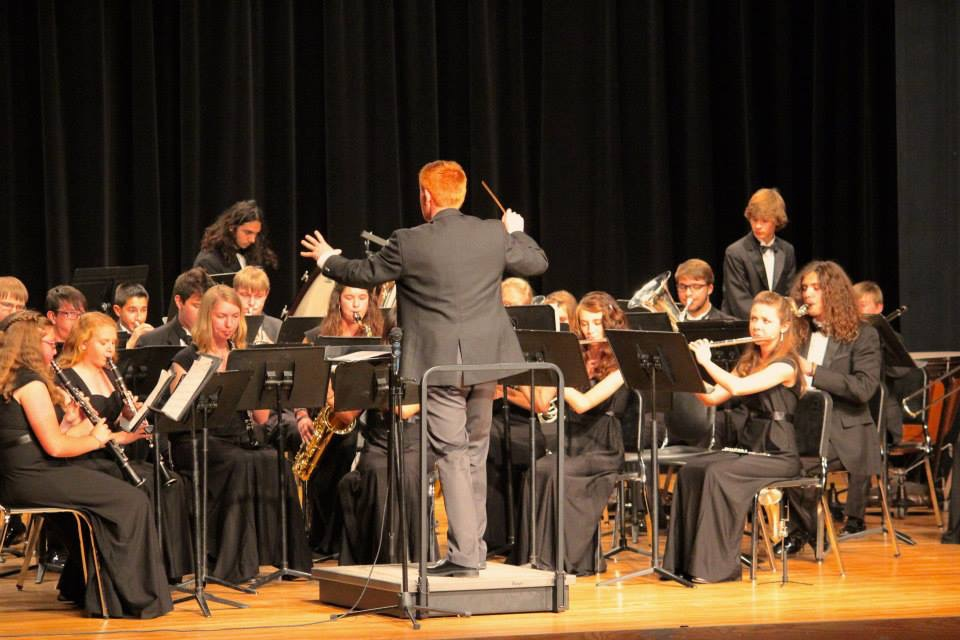 Photo: Jordan Millhollin conducts at Arapahoe High School