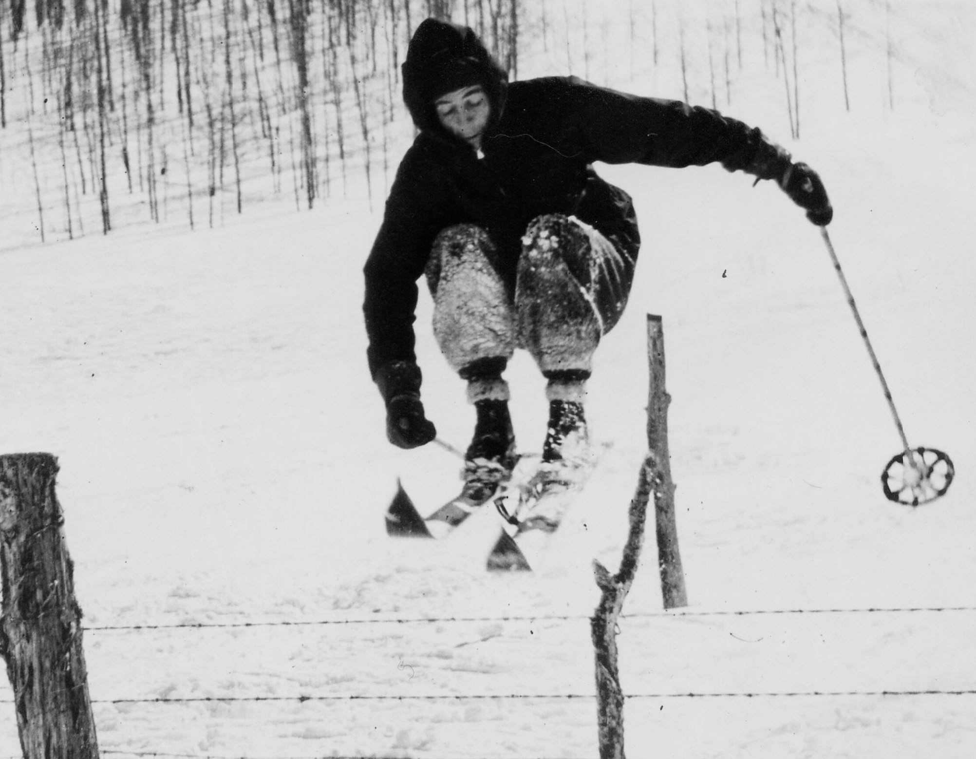 Photo: Lost Ski Areas book man jumping over fence Cropped