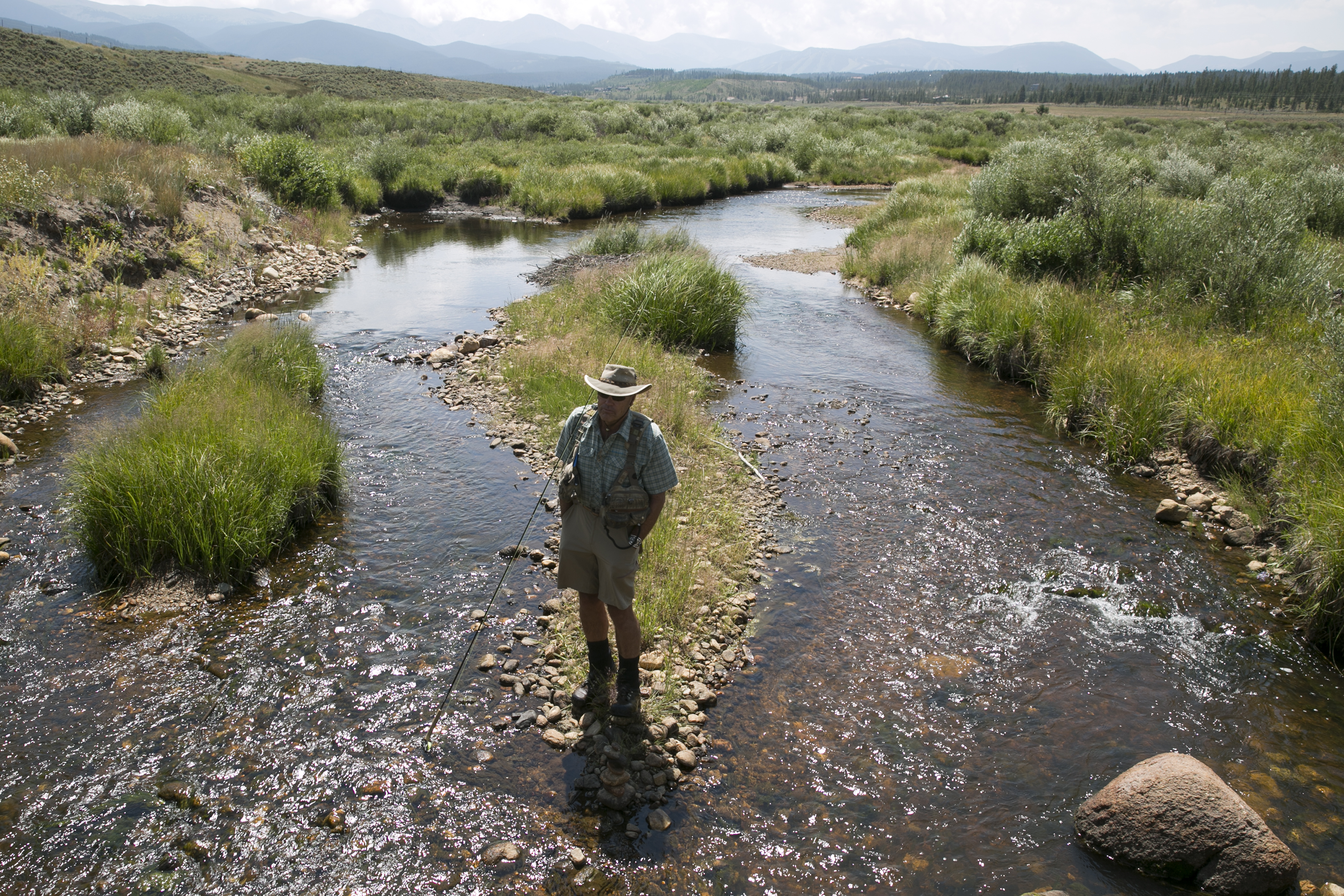 """KirkKlancke, president of the Colorado River Headwaters Chapter of Trout Unlimited, ona tributary of the Fraser River near his home on Grand Countyin early August 2018. """"It's really important for us to have a governor who prioritizes conservation, preservation of the environment that drives our tourist economy. That's key,"""" he says."""