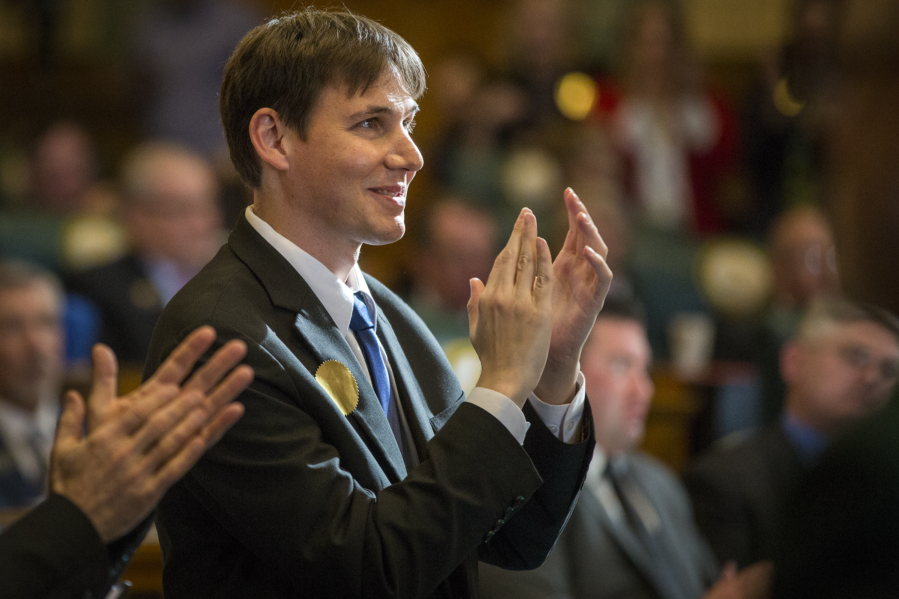 Marlon Reis, Gov. Jared Polis' partner, applauds during Polis' State of the State address to the General Assembly Thursday Jan. 10, 2013.