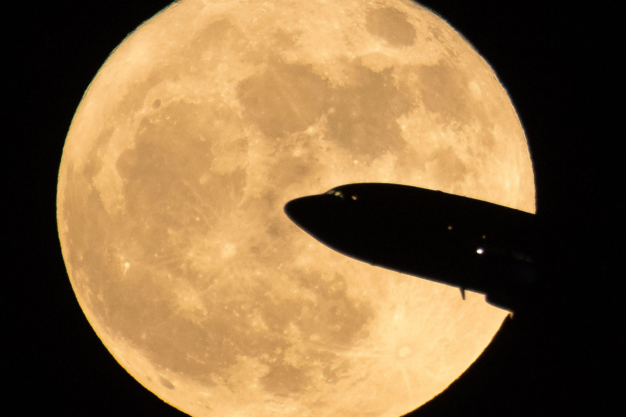 Photo: Supermoon | Aircraft Takes Off In Front Of Moon - NASA