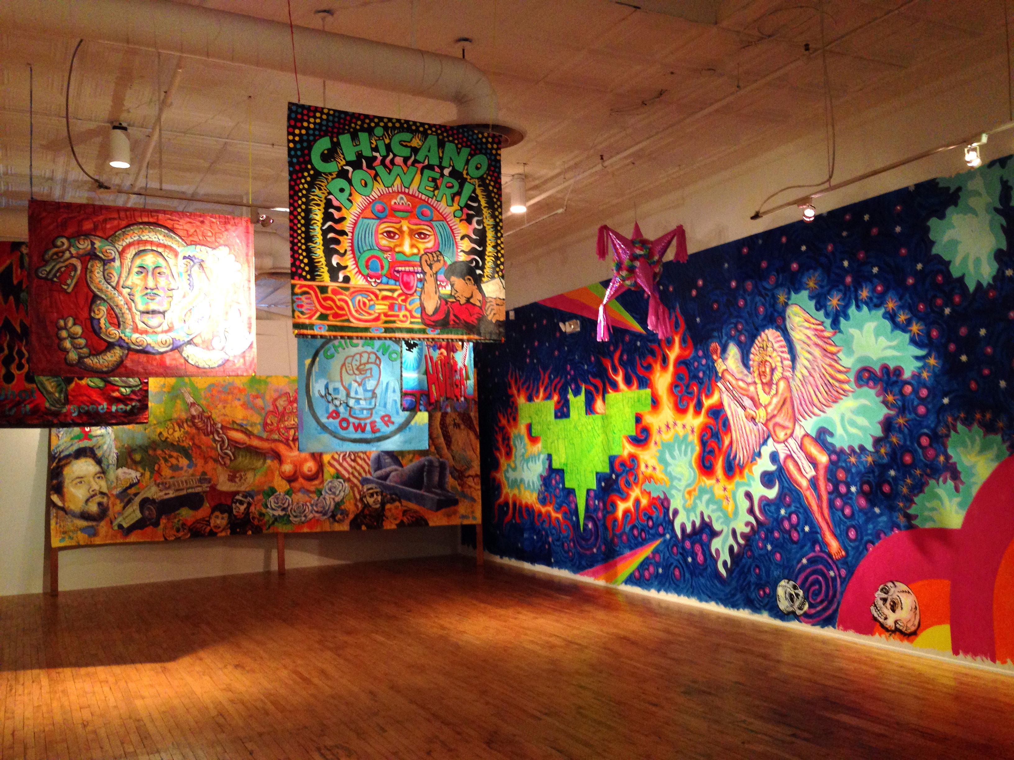 Photo: Murals by Carlos Fresquez and Francisco Zamora at Museo de las Americas