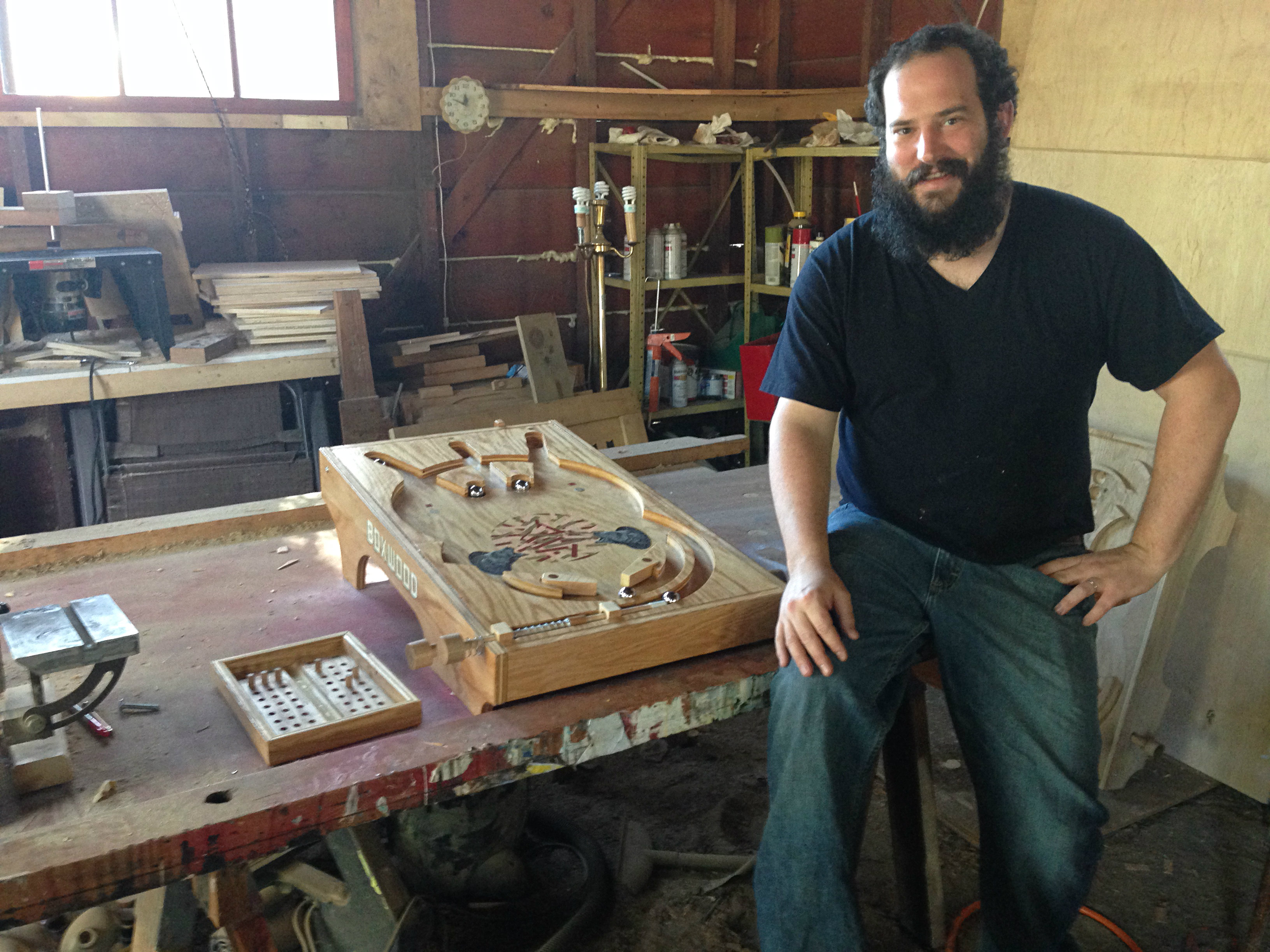 Photo: Artist William Manke with a Boxwood pinball machine