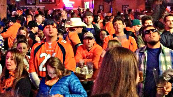 Photo: Denver Broncos fans watching the Super Bowl