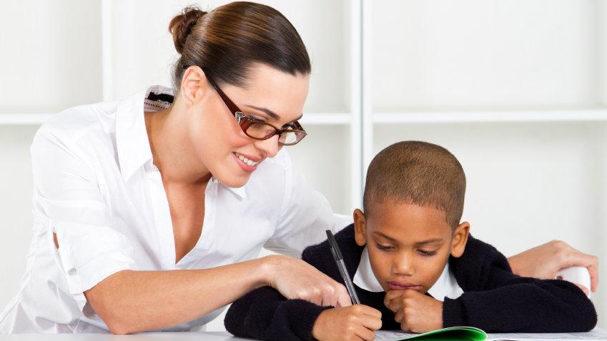 Photo: White teacher, student of color (iStock)