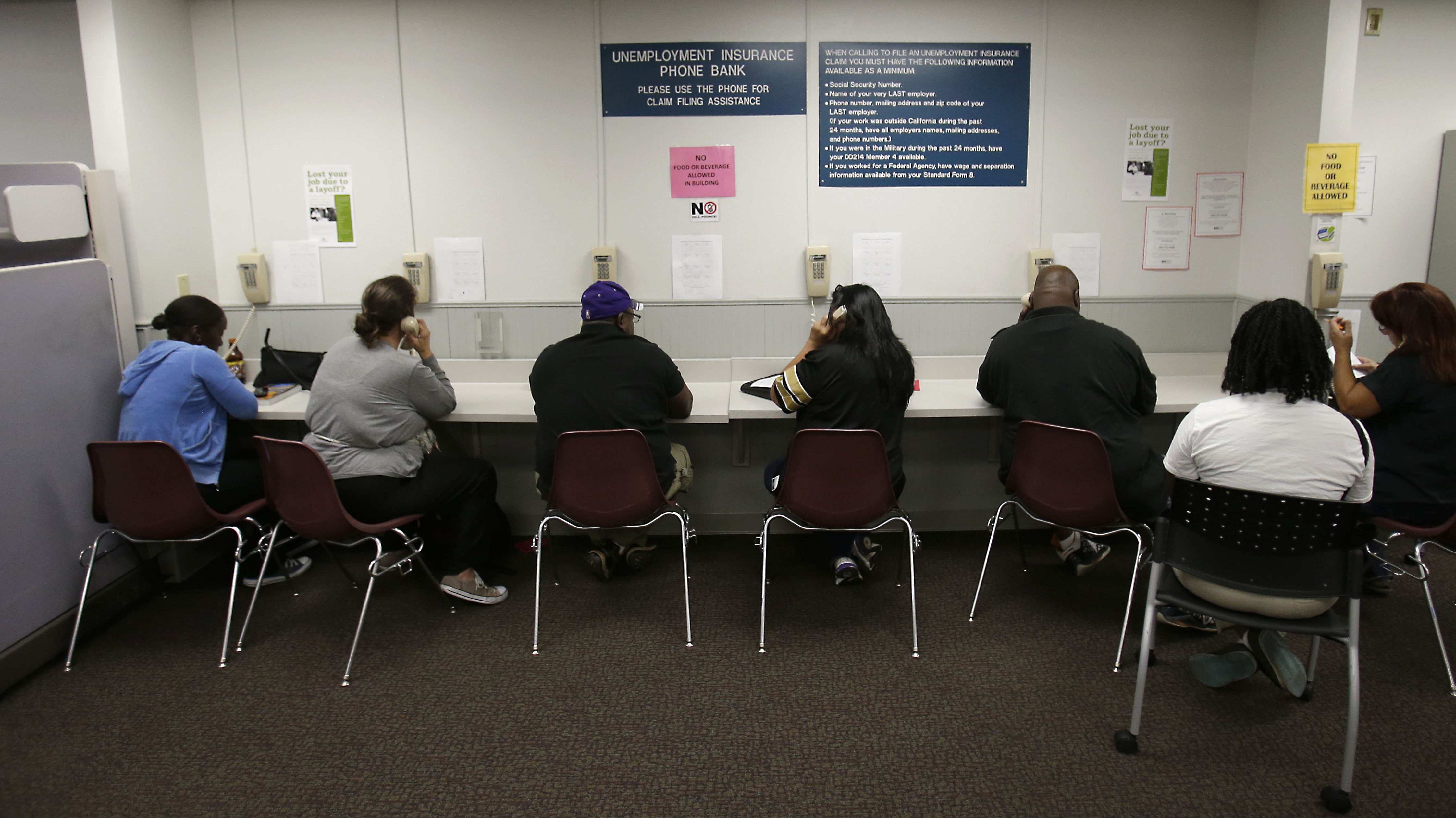 Visitors use the Unemployment Insurance Phone Bank in Sacramento, Calif., in 2014.