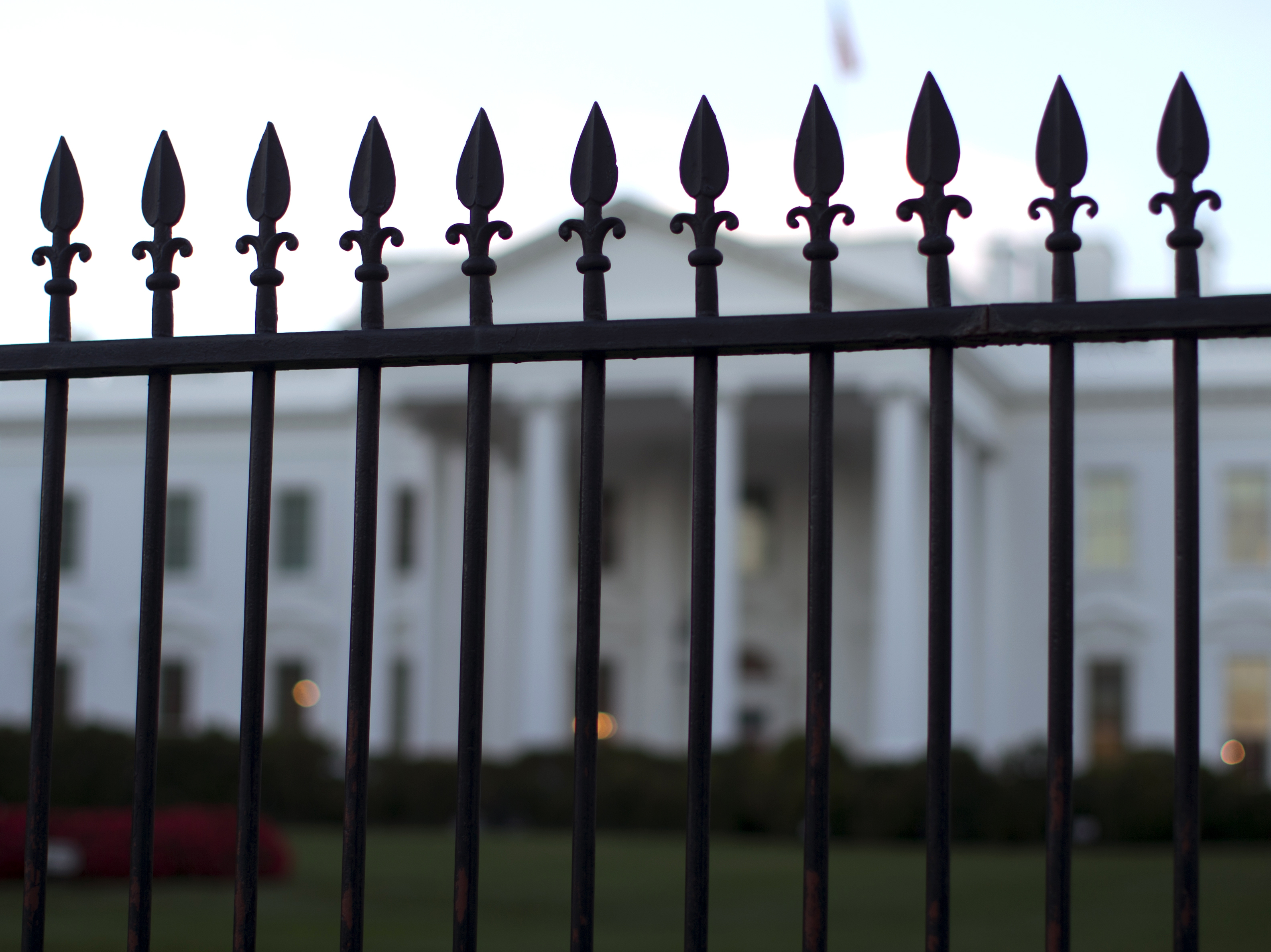 The White House is seen through the North Lawn perimeter fence in Washington, Sept. 23, 2014.