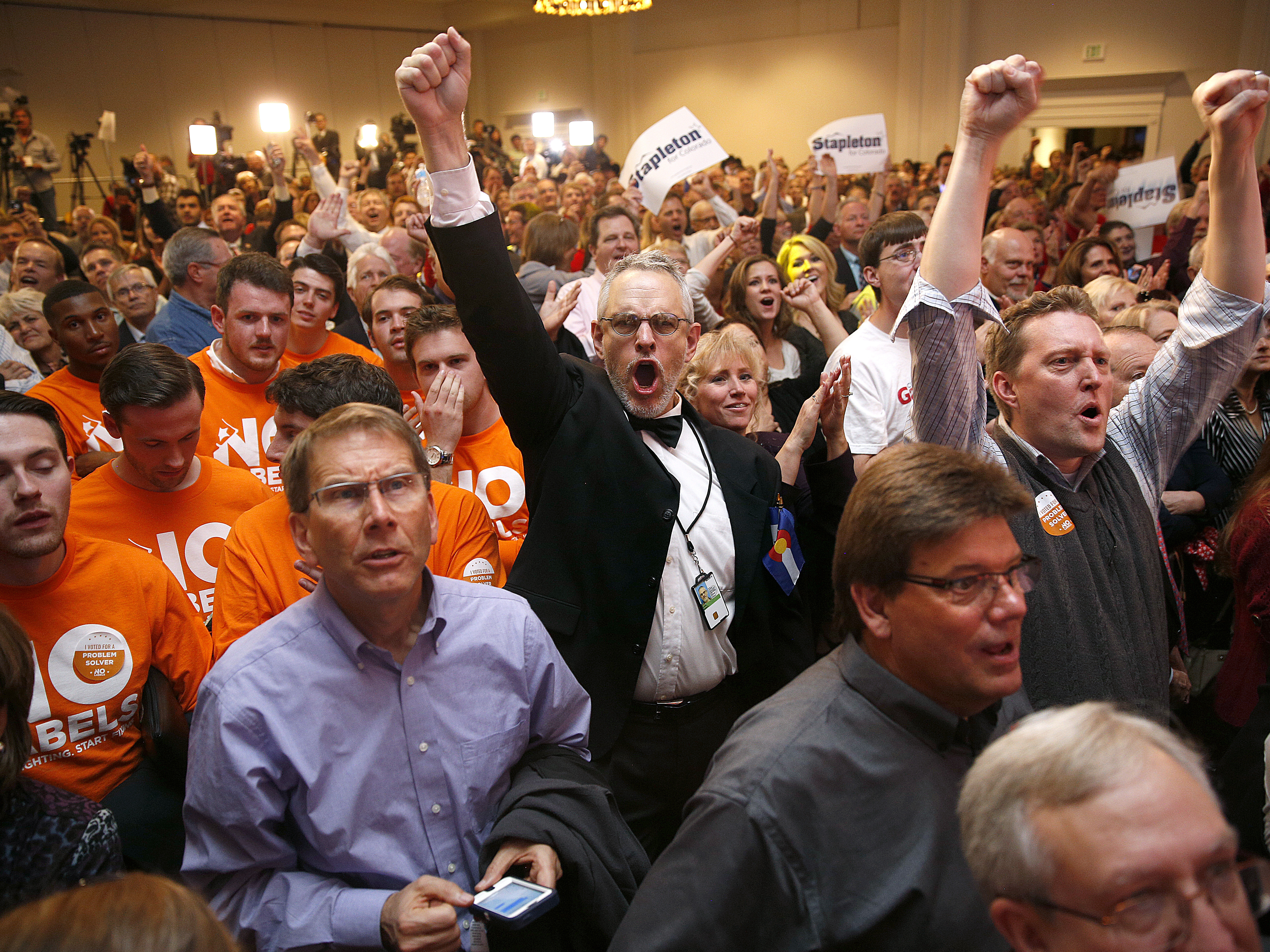 Republican supporters cheer in Colorado Springs, Colo., as a television broadcast declares the Republicans had taken control of the Senate. Republican candidates, party committees and outside groups spent about $44 million more than Democrats, according to the Center for Responsive Politics.