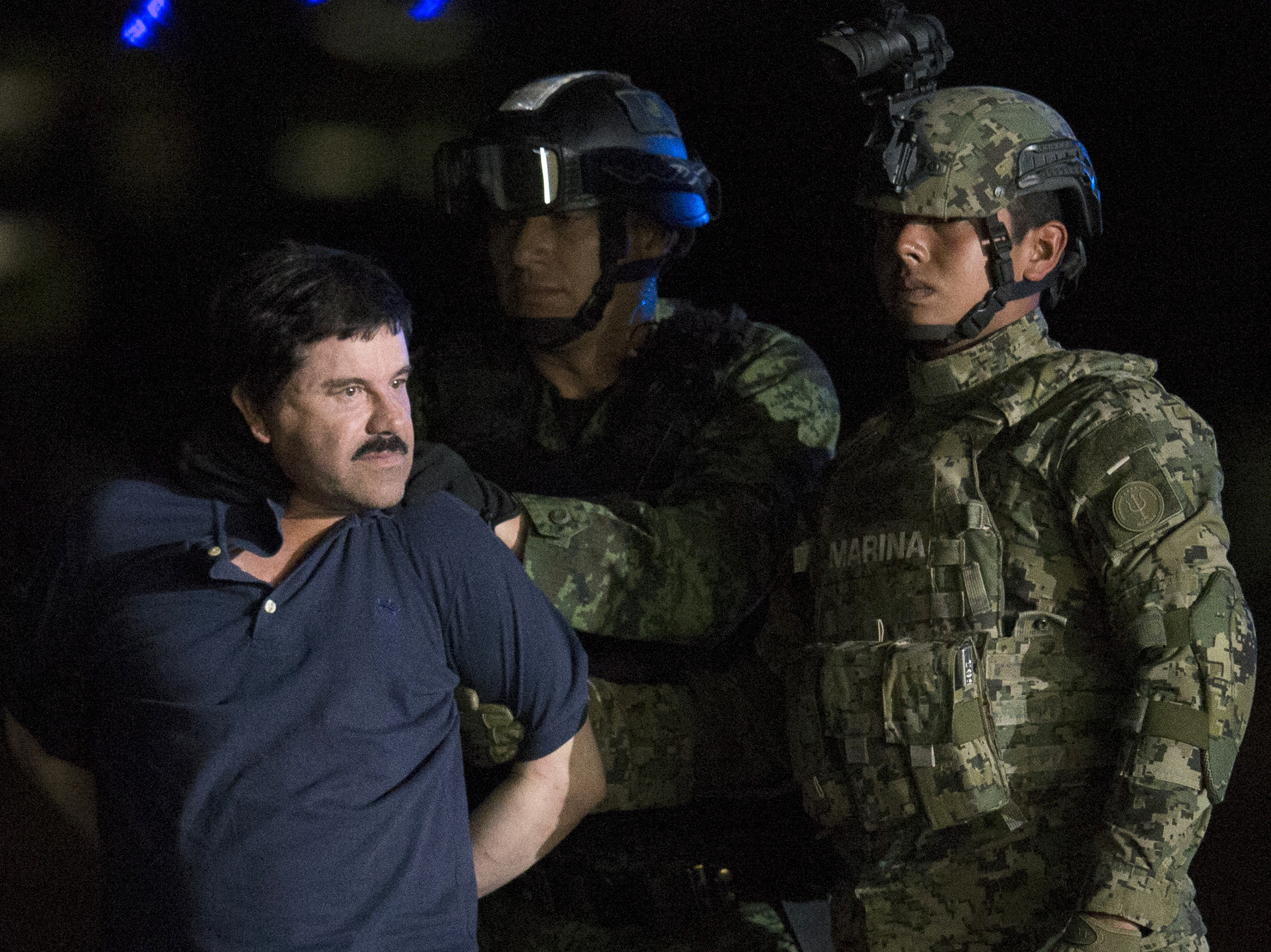 Joaquin Guzman El Chapo is taken to a federal hangar in Mexico by Mexican army soldiers in 2016.