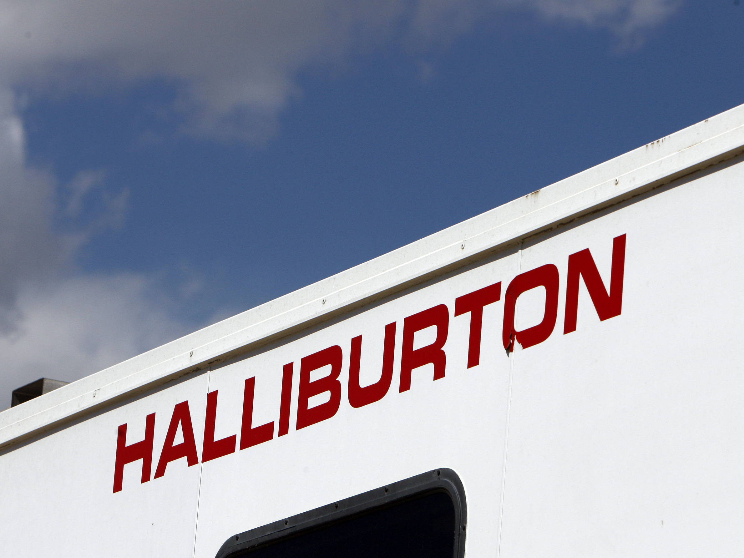 In this April 15, 2009 file photo, the Halliburton sign adorns the side of a machine being used by the company at a site for natural-gas producer Williams in Rulison, Colo.