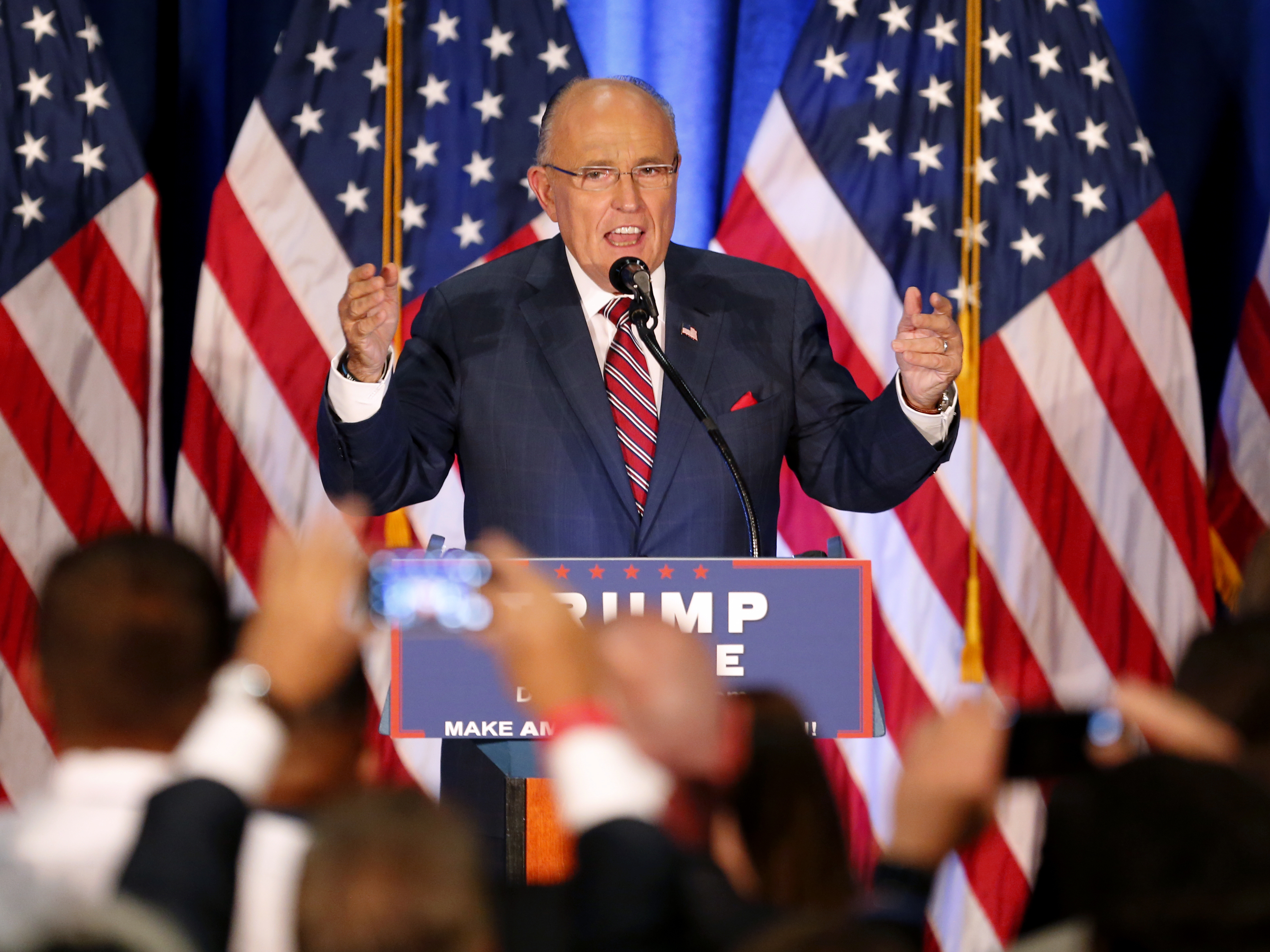 Former New York Mayor Rudolph Giuliani speaks before Republican presidential candidate Donald Trump in Youngstown, Ohio, on Monday.