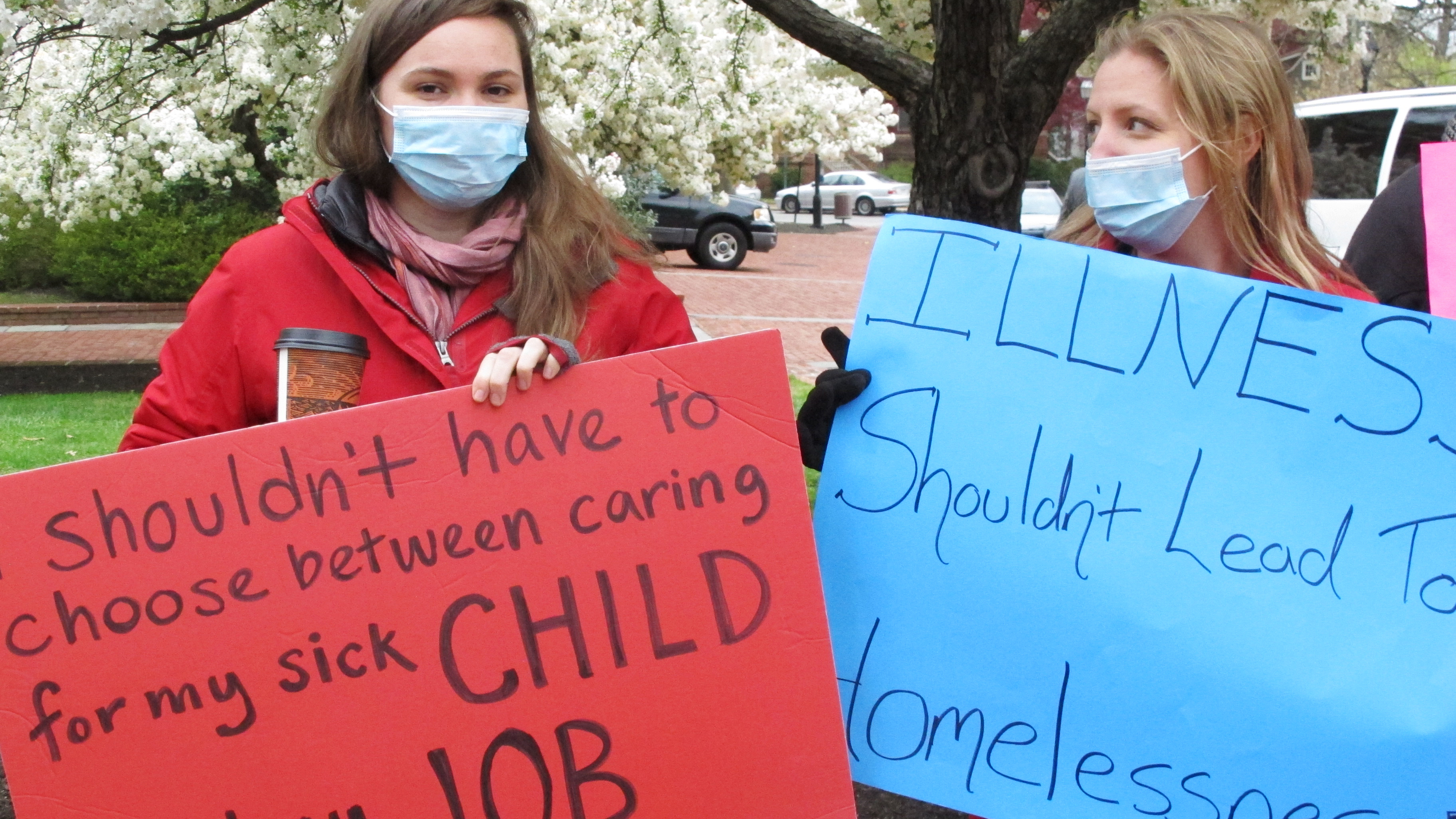 Sandy Robson (left) and Crystal Hall rally for legislation for paid sick leave on April 11, 2016, in Annapolis, Md. Under a bill recently sent to Gov. Larry Hogan, businesses with 15 or more full-time employees would be required to allow workers to earn at least five paid sick days a year.