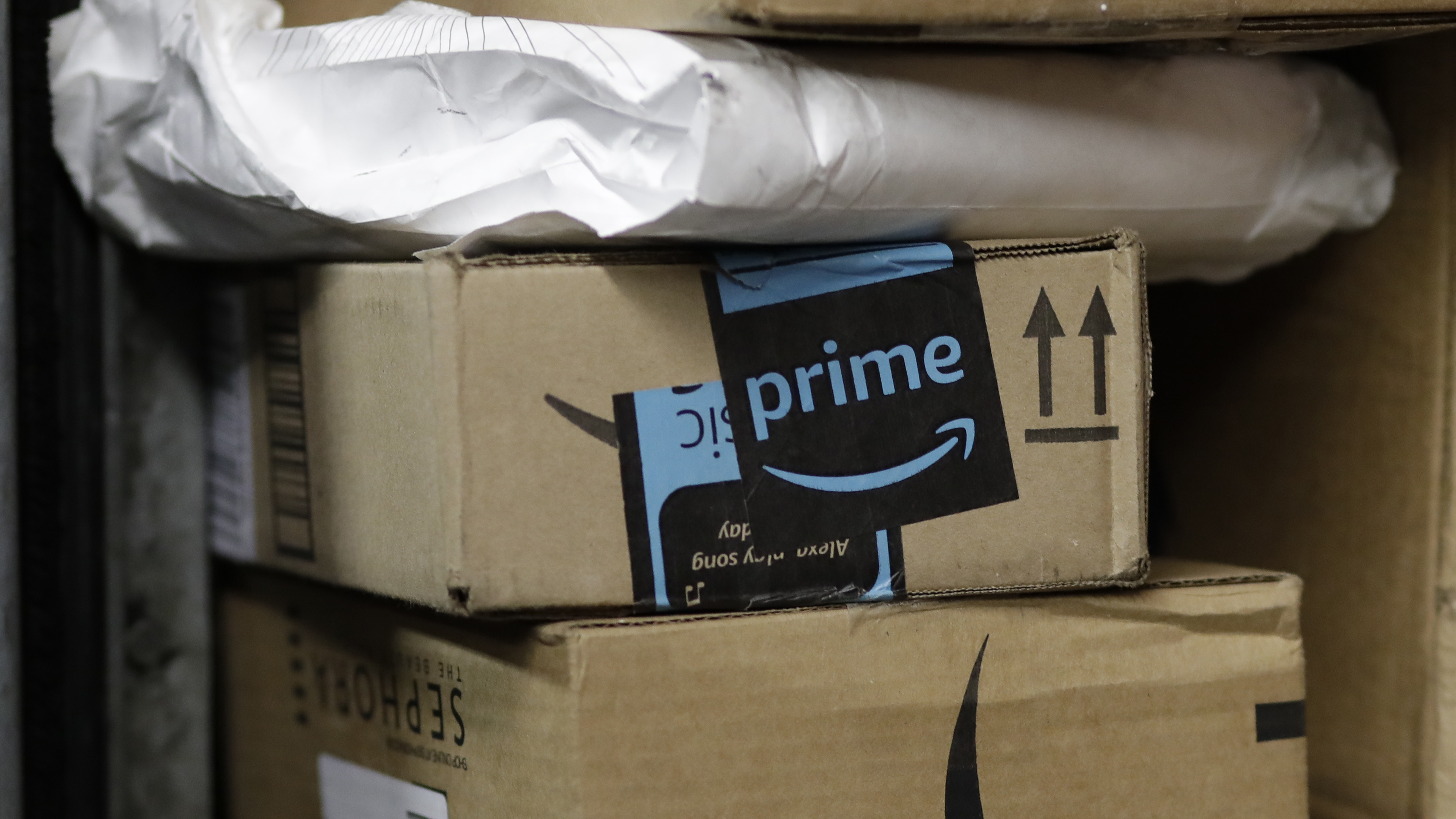 A stack of Amazon delivery boxes.