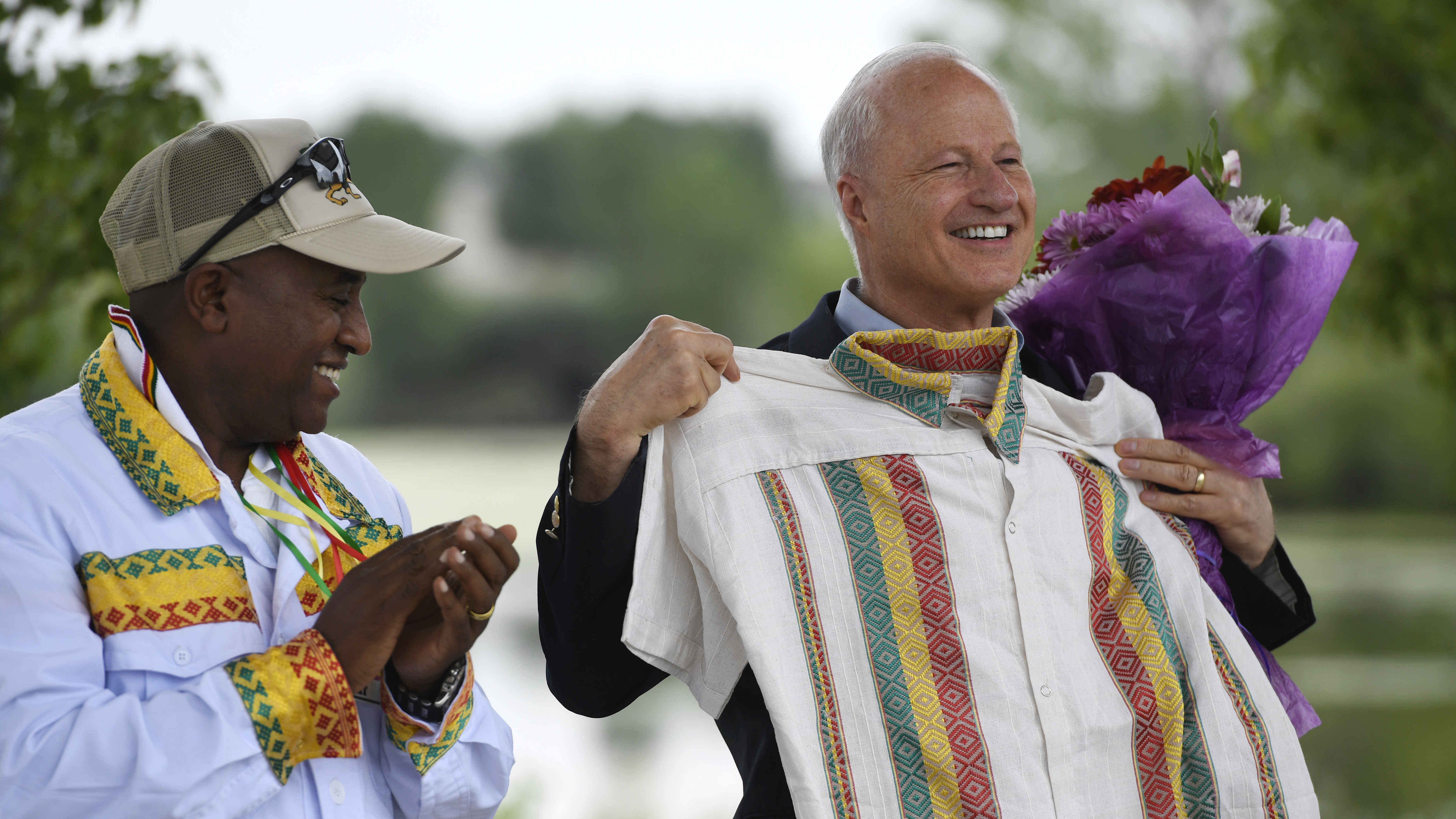 Then-U.S. Rep. Mike Coffman accepts a gift of a traditional Ethiopian shirt from Girum Alemayehu at an Ethiopian festival in Denver in August 2016. Coffman is waiting to hear election results from 2019 to hear if he will be Aurora's next mayor.