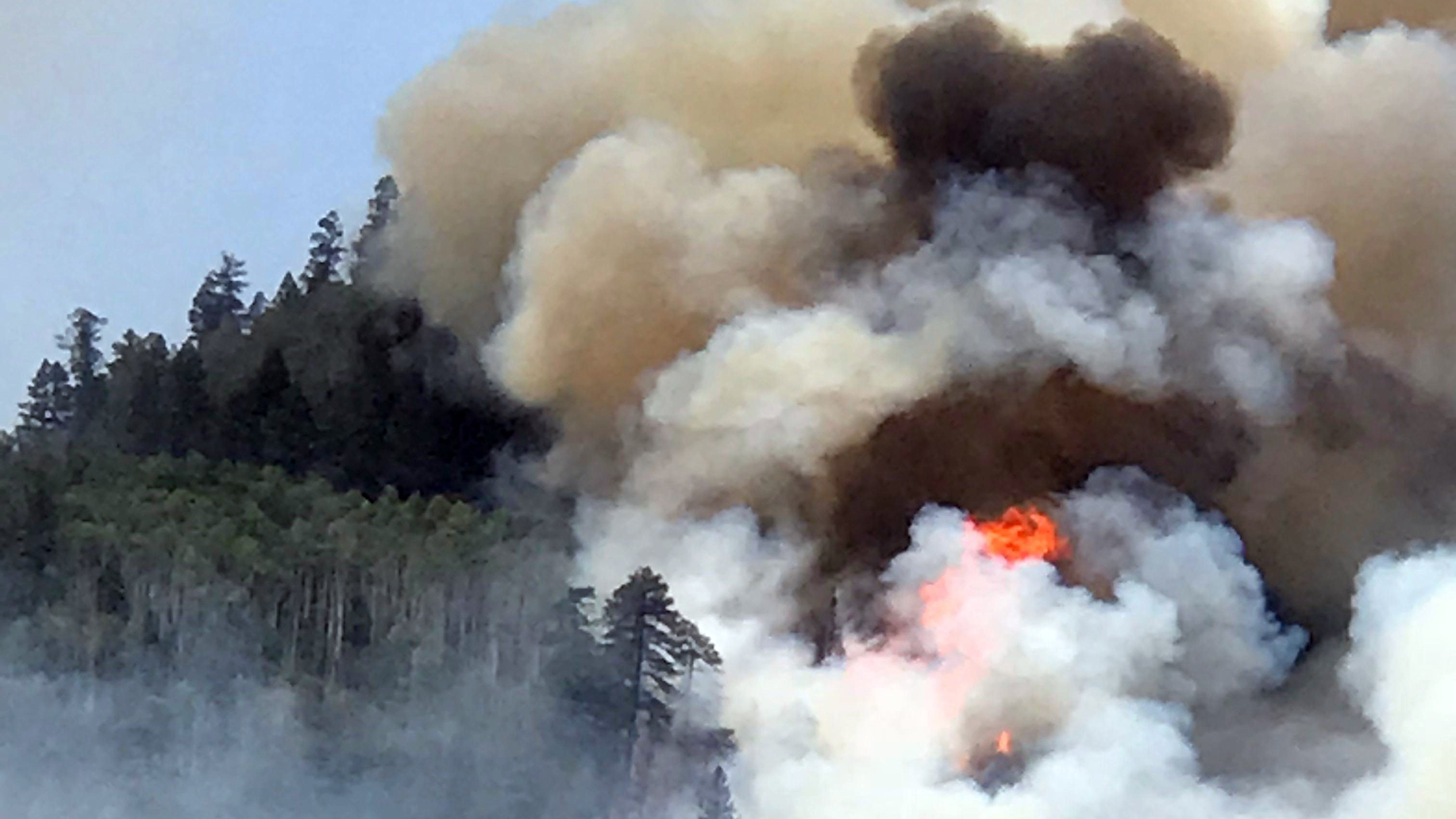 Flames and smoke billow skyward as a wildfire burns near Durango, Colo. on June 7, 2018. The 416 Fire continued to burn more than 27,000 acres Wednesday morning, causing the closure of a nearby national forest.