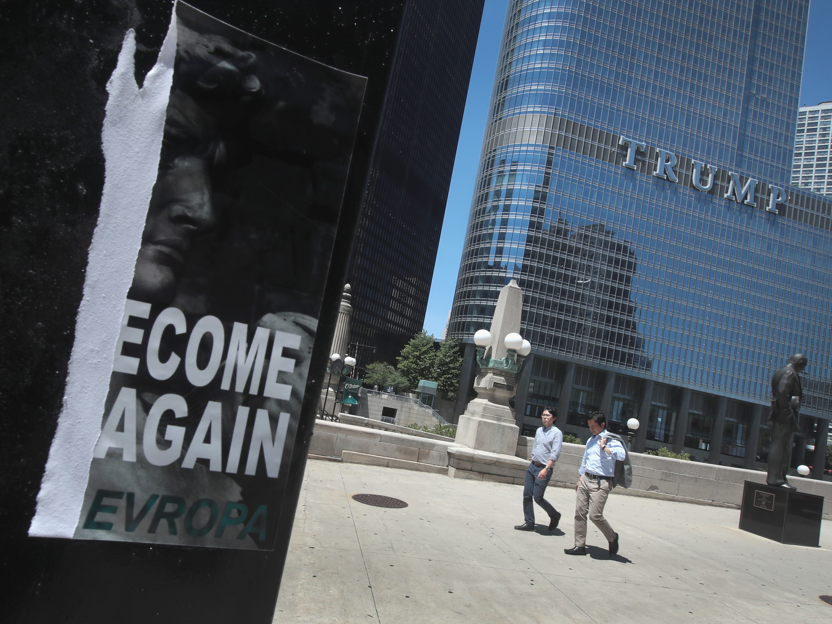A defaced recruiting flyer for Identity Evropa hangs near Trump Tower in Chicago, in July 2016. The flyer which read