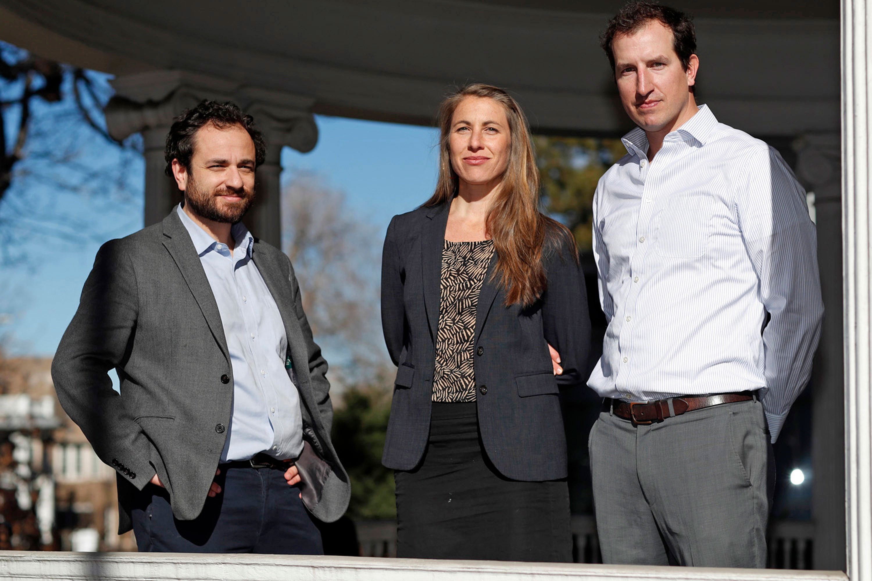 In this Dec. 20, 2018 file photo attorneys, from left, David Seligman, Nina DiSalvo and Alexander Hood, of Towards Justice, pose outside the organization's office east of downtown Denver. Low paid childcare workers from around the world could soon learn whether they will be getting payments from a proposed $65.5 million class action settlement. A federal judge in Denver is scheduled to hold a hearing Thursday, July 18, 2019, on whether to grant final approval to the deal, which was announced in January.
