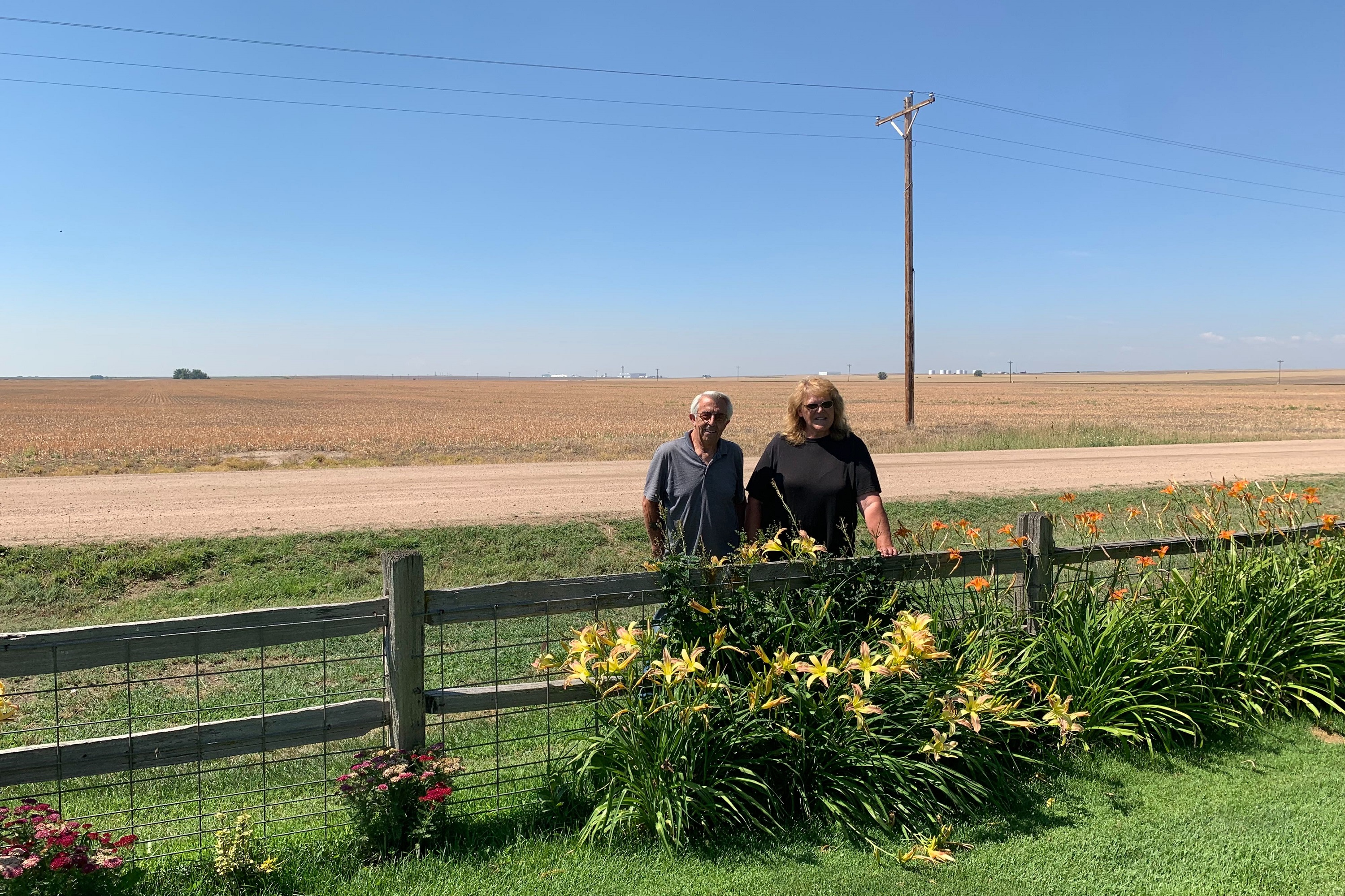 Tom and Jerilyn James stand outside their home of 35 years. The land used to be quiet and rural, but in 1995, everything changed when DIA opened.