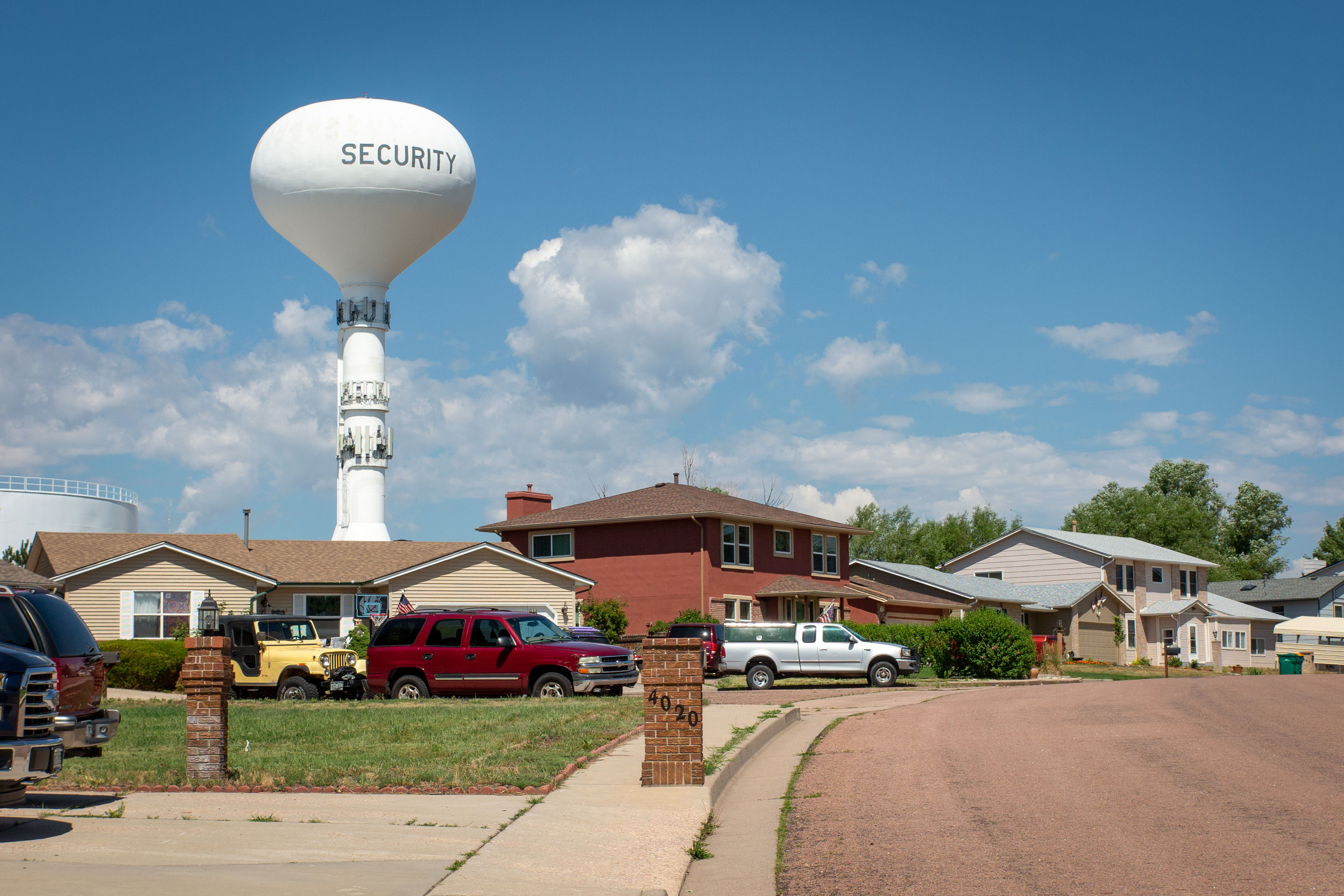The Security water tower stands over the town, July 29, 2019. Until a new water treatment center is finished to appropriately filter PFAS, the local water district will continue to buy water from nearby Colorado Springs.