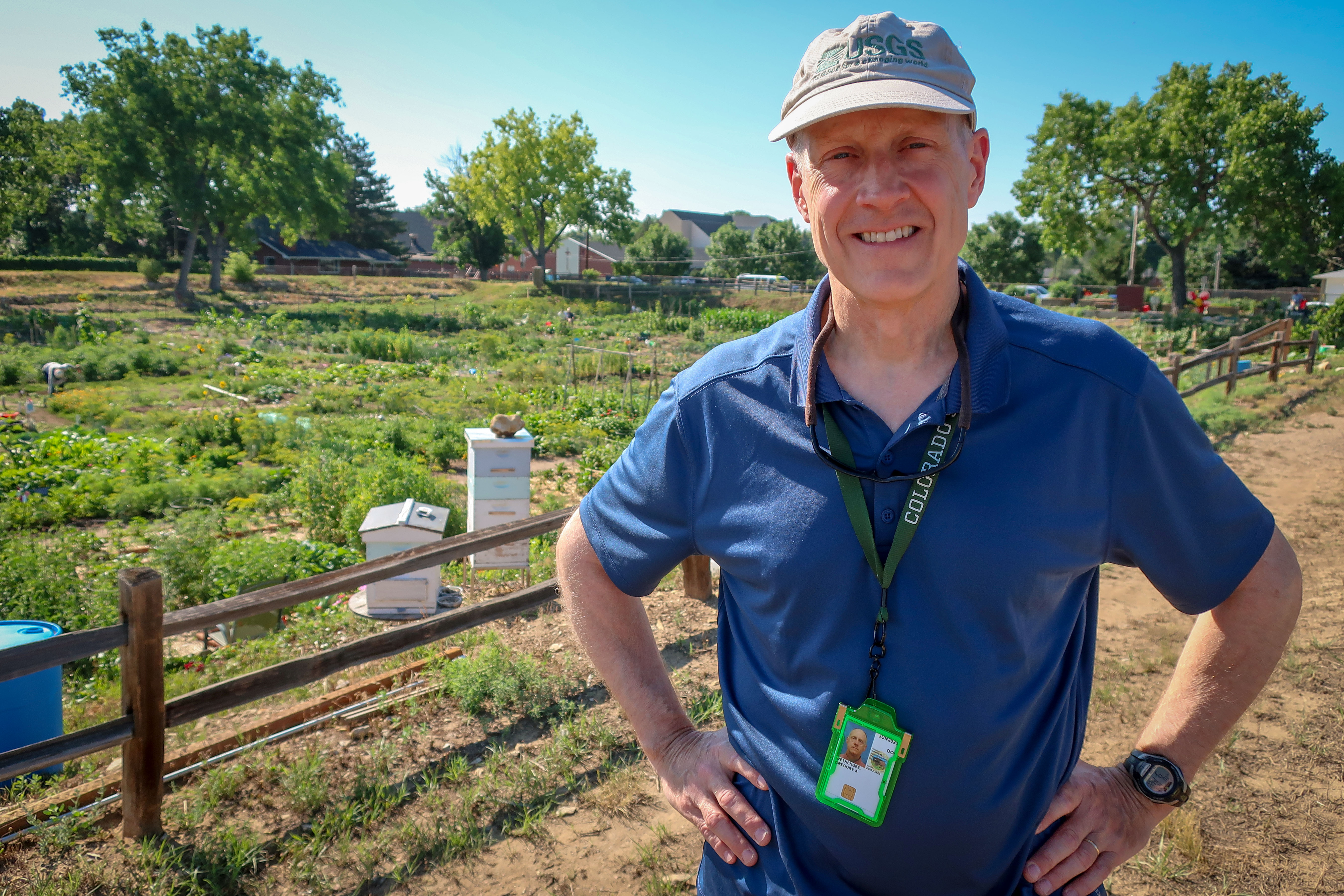 Gregory Wetherbee, a research chemist with the USGS, stands at an urban rainwater collection site at the Arvada Community Gardens.