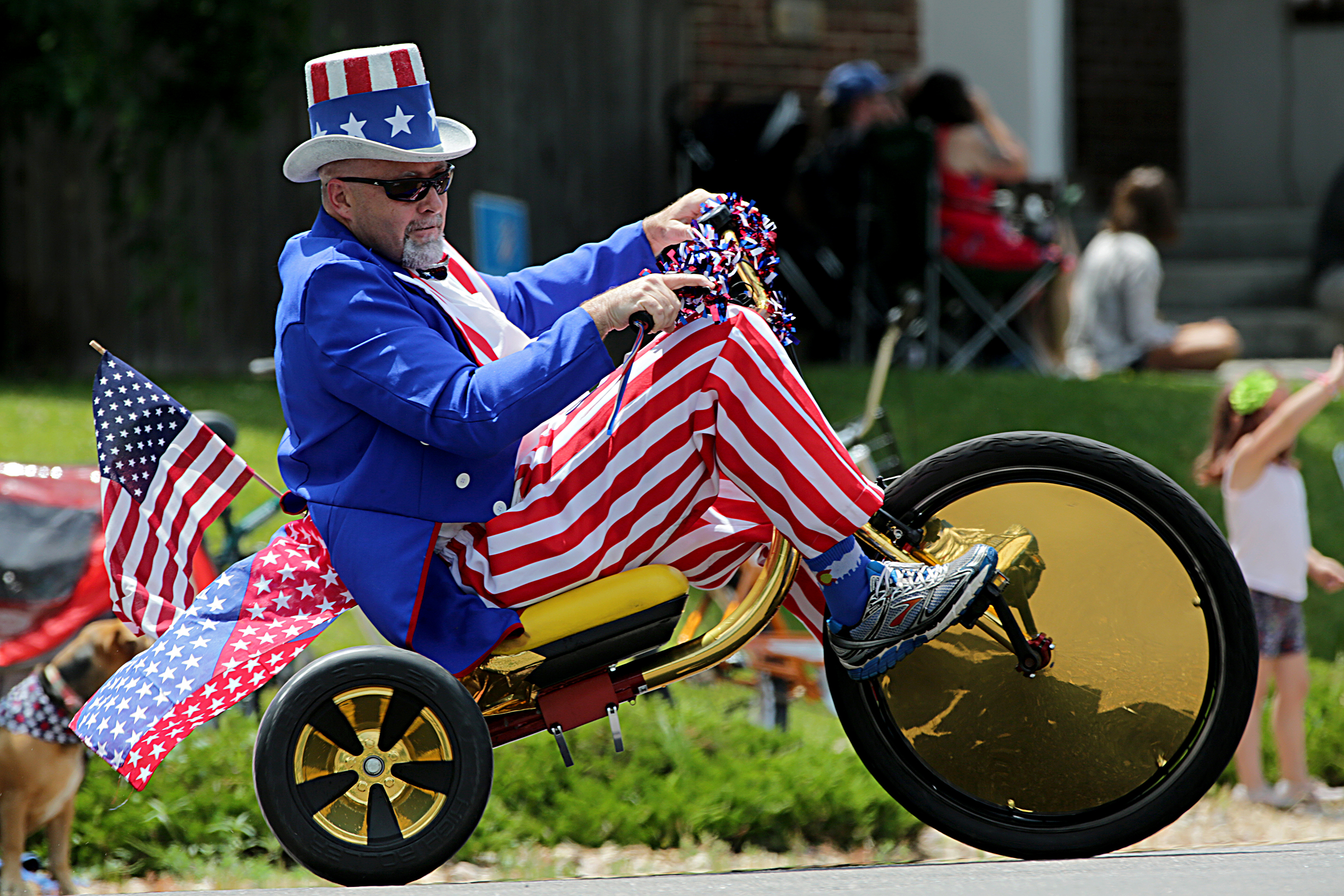 The Park Hill neighborhood in Denver hosts an old-school Independence Day parade every Fourth of July, with families crowding the route up 23rd Avenue east of City Park. Uncle Sam showed up on a Big Wheel. We note the Colorado socks.
