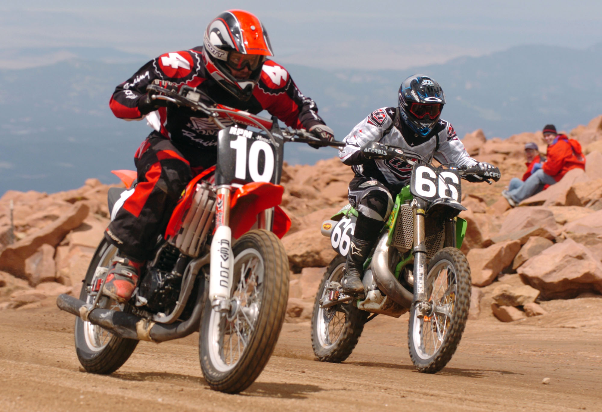 In this June 2004 file photo, Teague Sawyer, left, races to the finish line with Mark Woodward in the 500cc motorcyle category of the 82nd Pikes Peak International Hill Climb near Manitou Springs, Colo.