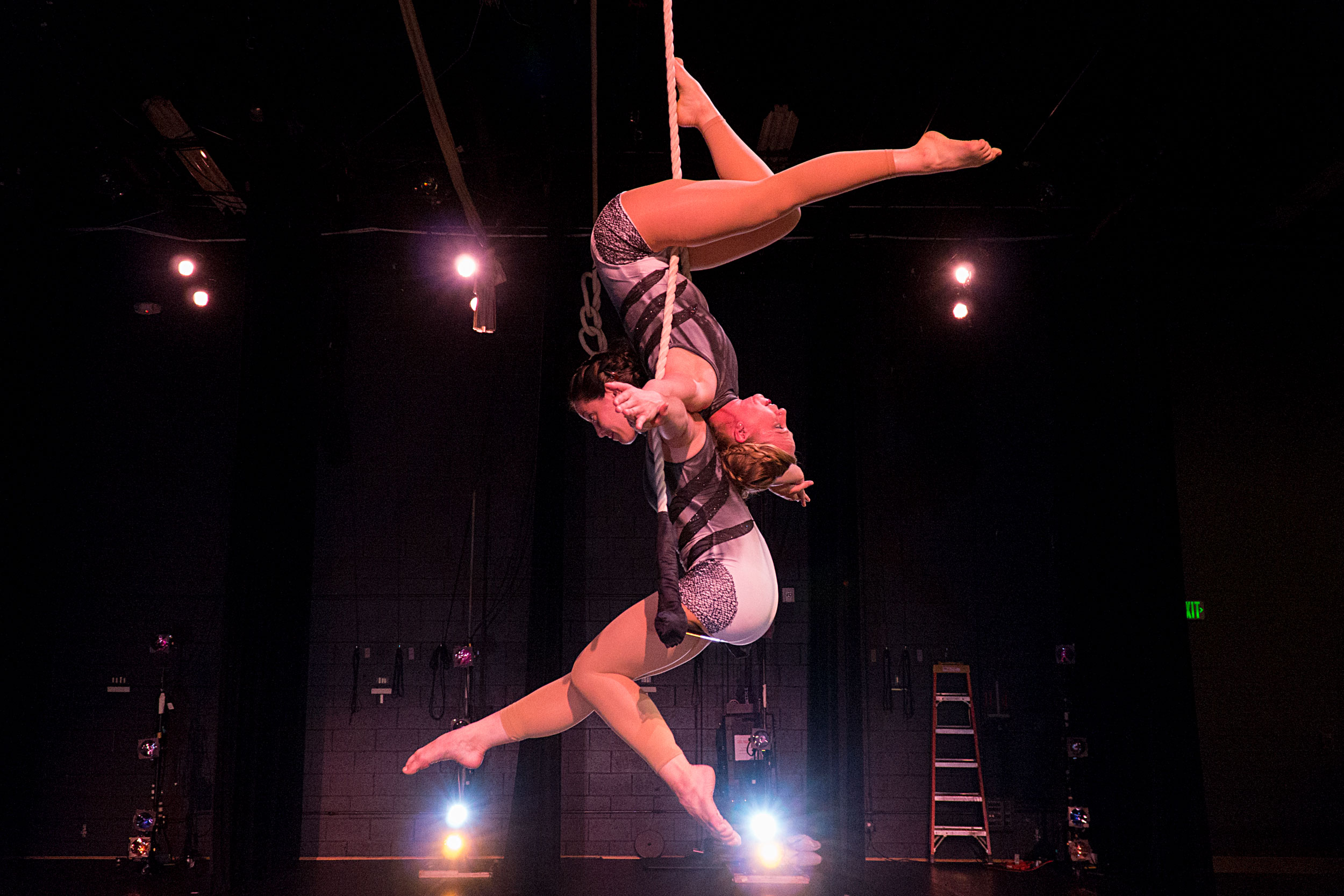 Megan Cattau and Alysha Perrin on a dance trapeze during a tech rehearsal for Frequent Flyers dance company's Aerial Dance Festival at the Dairy Arts Center in Boulder on July 30, 2019.