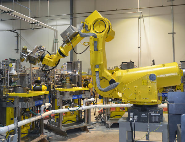Igor, a robot used to train workers at the Pueblo Chemical Agent-Destruction Pilot Plant, lifts a 155-millimeter shell to demonstrate how liquid mustard agent is removed.