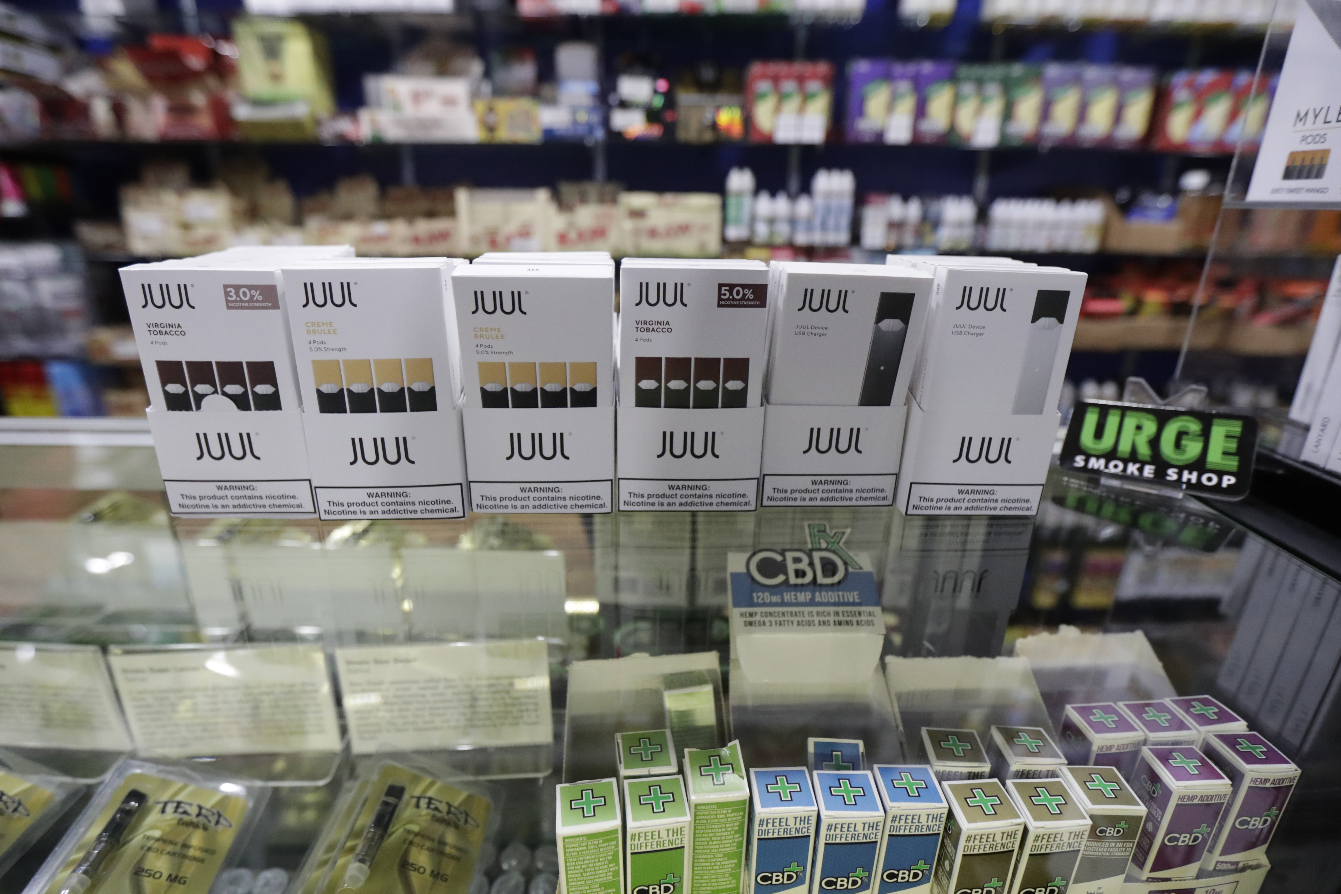 Packages of Juul electronic cigarettes are seen on display at Urge, a smoke shop in Hoboken, N.J., in December 2018.